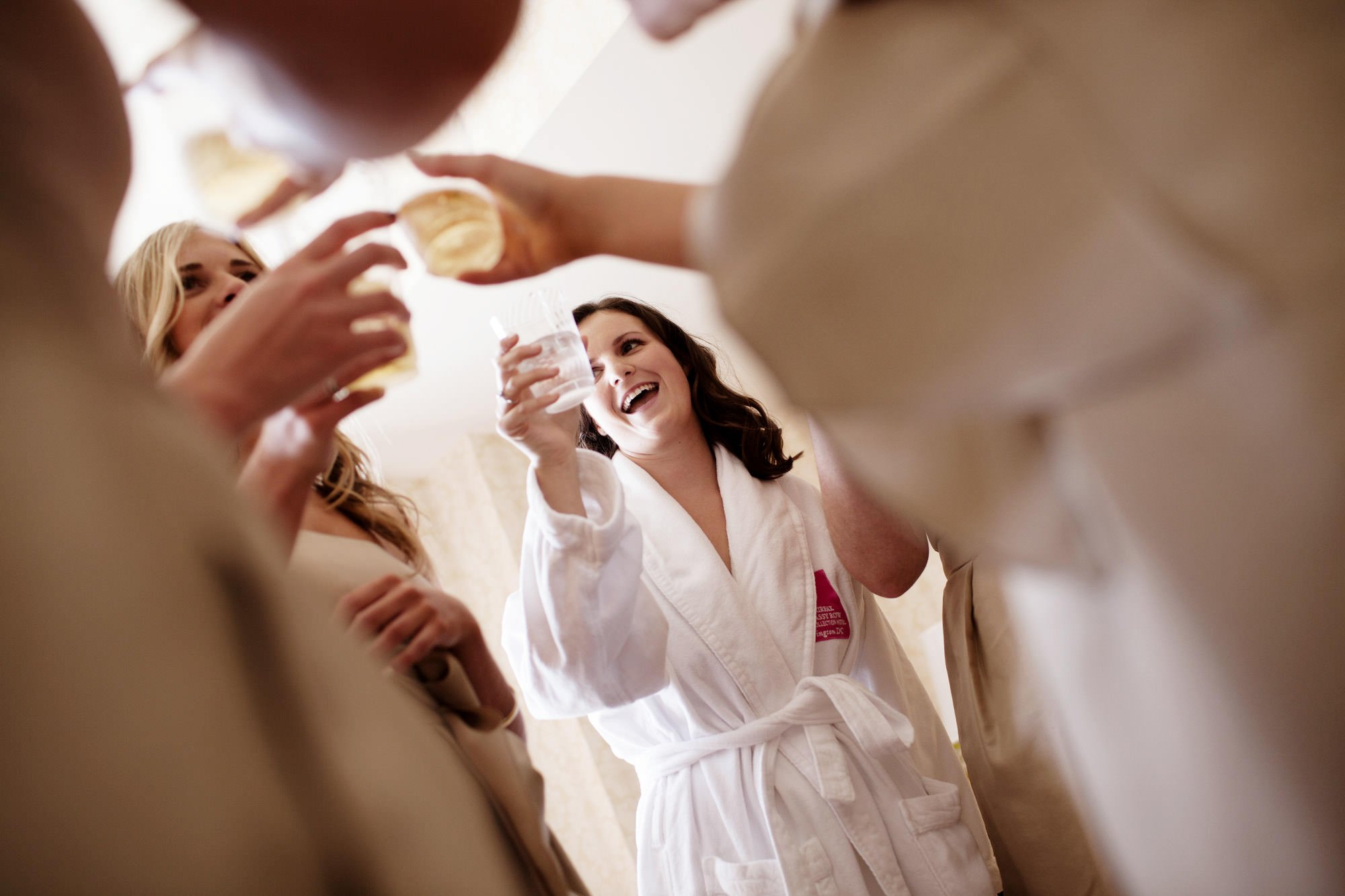 The bride toasts with her bridal party before her Sulgrave Club wedding reception.