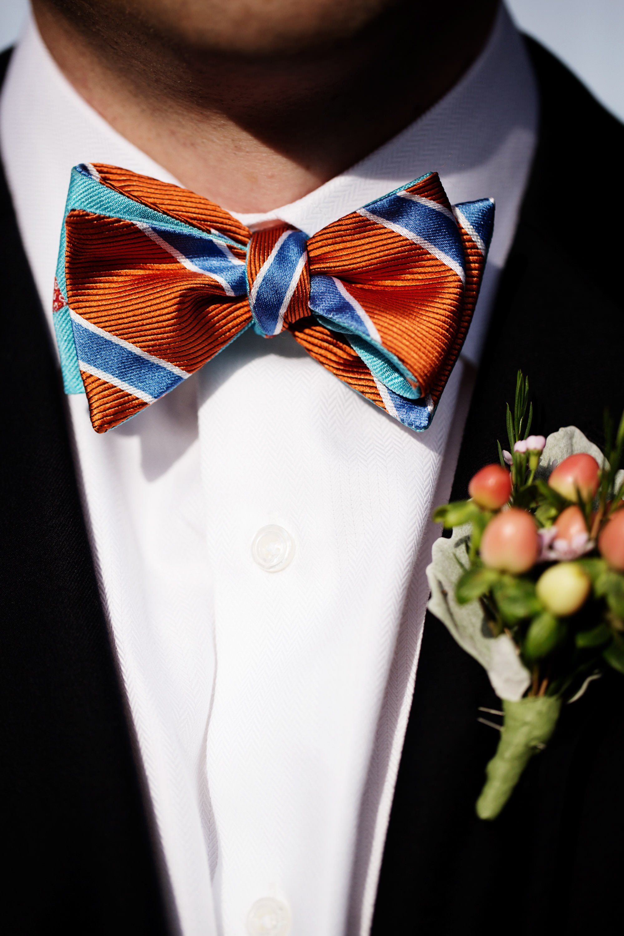 A detail of a groomsman's bowtie.