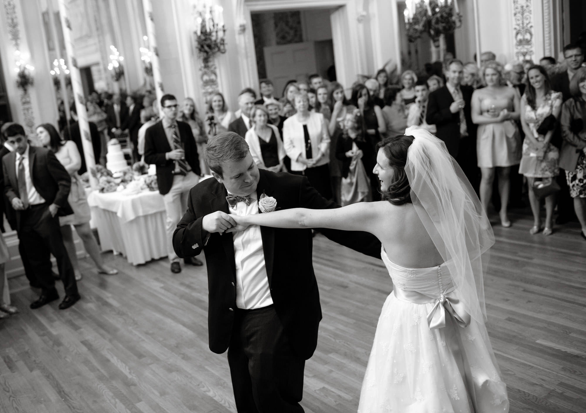 The bride and groom dance during the wedding reception at Sulgrave Club.