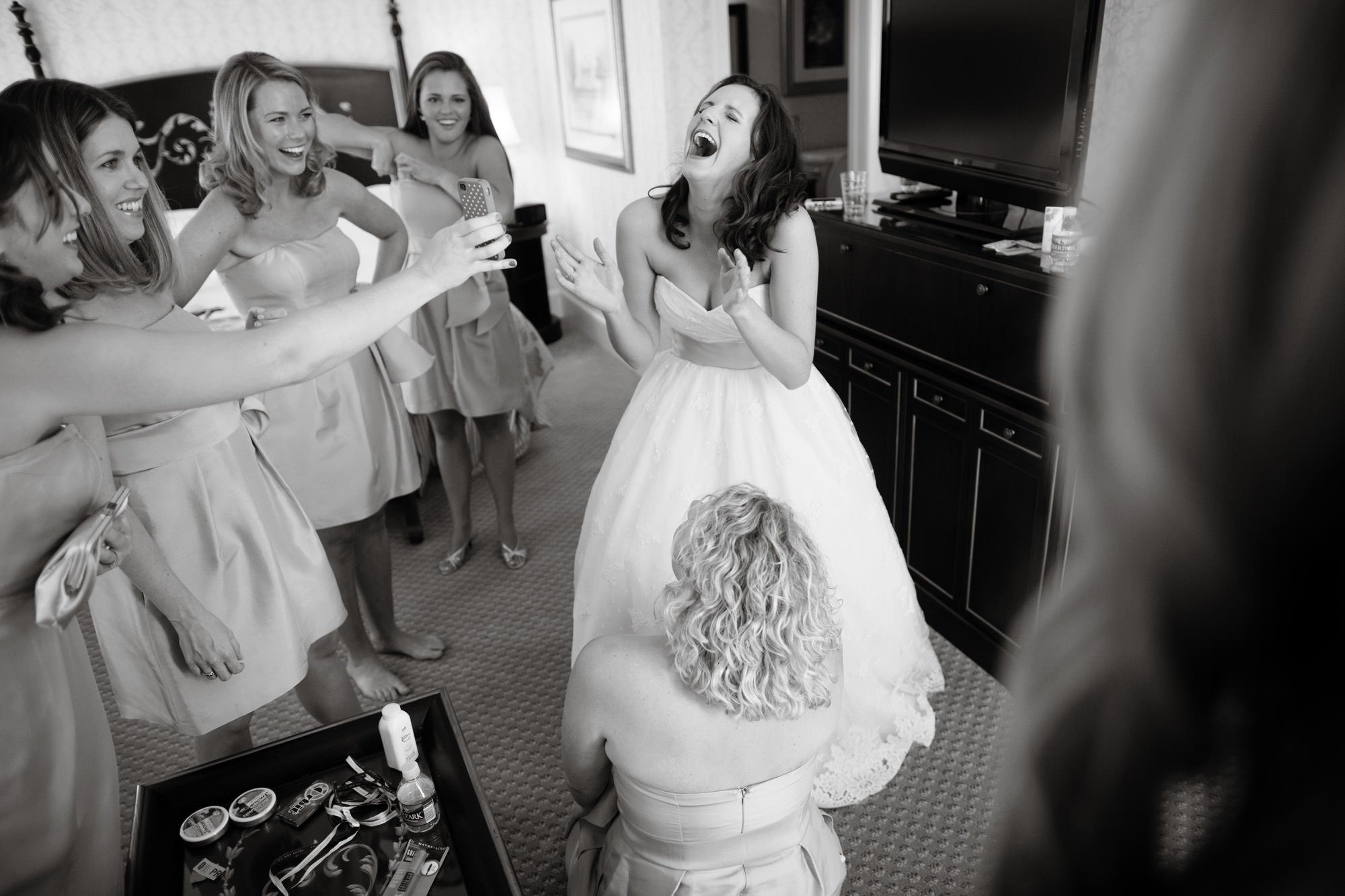 The bride laughs with her bridal party before her Sulgrave Club wedding reception.