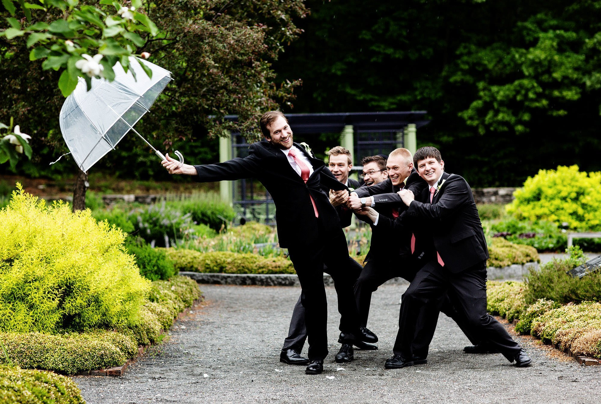 The groomsmen pose for a silly portrait during this Tower Hill Botanic Garden Wedding.