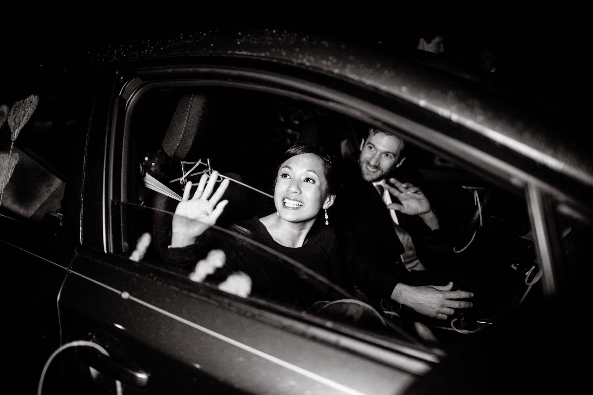 The bride and groom wave goodbye to their guests following their Tower Hill Botanic Garden Wedding reception.