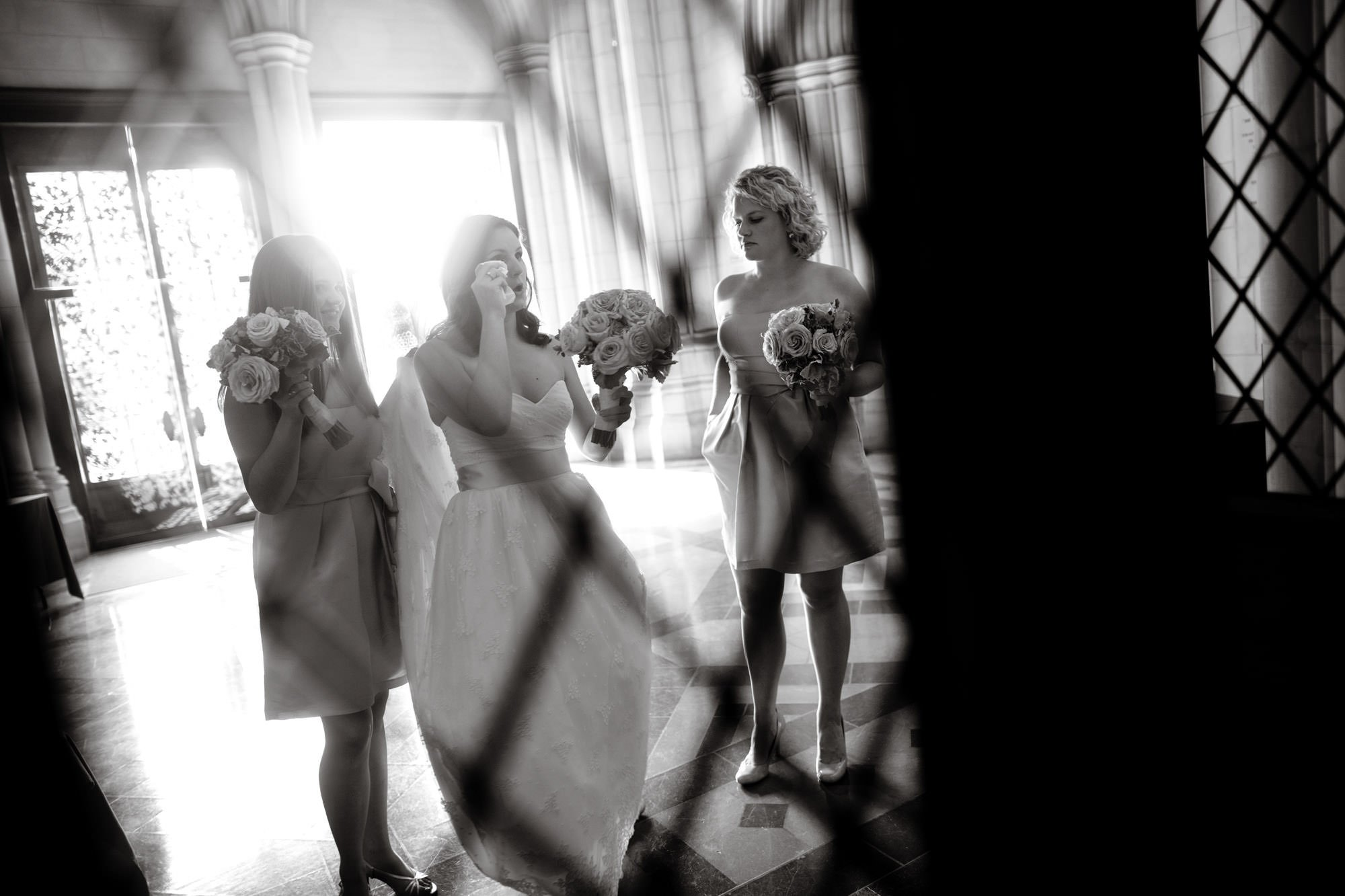 The bride waits for the ceremony to begin on her Washington National Cathedral wedding day.