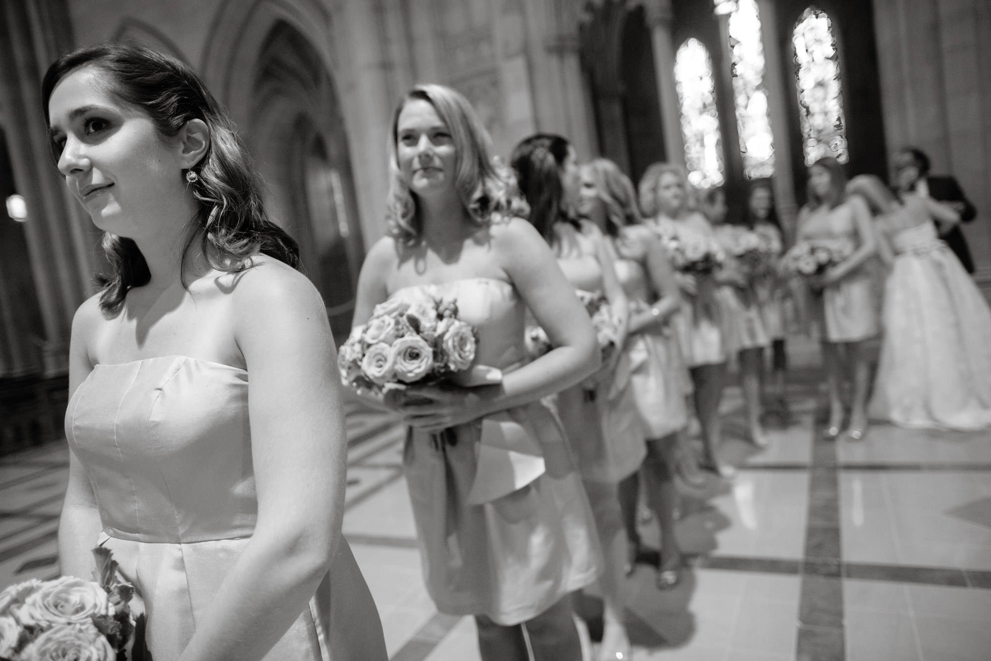 Bridesmaids wait to process down the aisle during this Washington National Cathedral wedding.