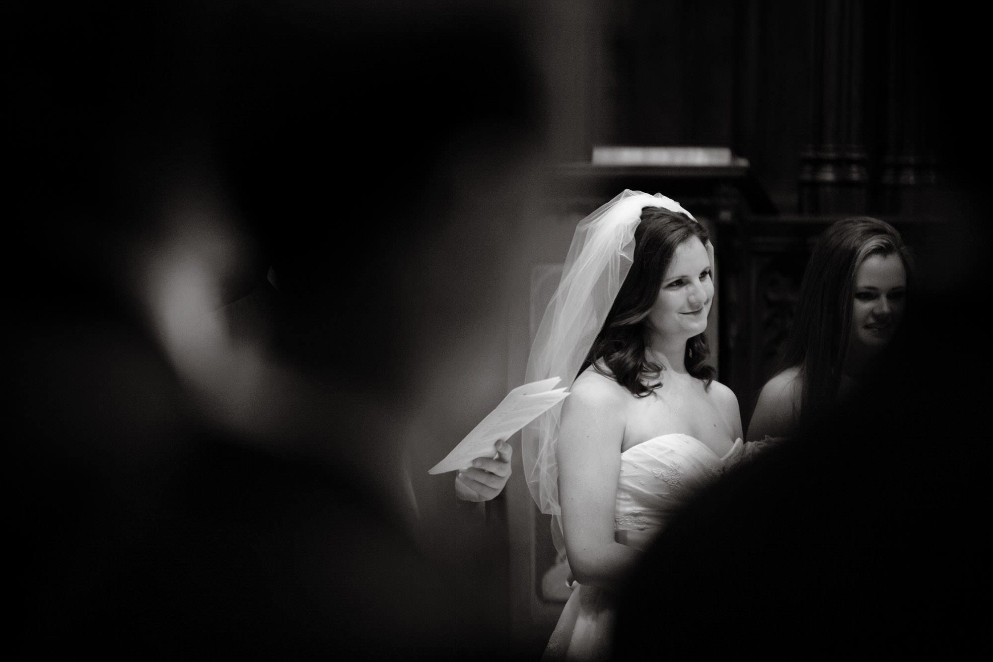 The bride smiles at her groom at her Washington National Cathedral wedding ceremony.