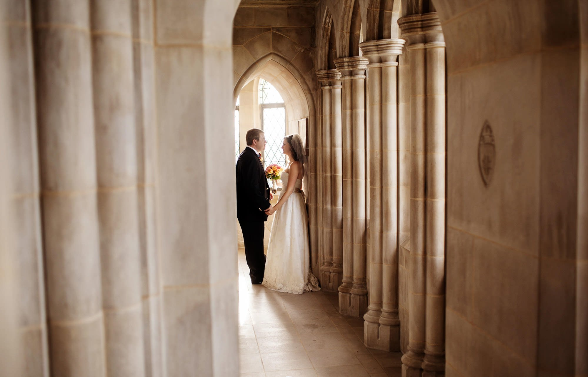 Washington National Cathedral Wedding  I  The bride and groom stand in the Observation Deck of the Washington National Cathedral following their wedding ceremony.