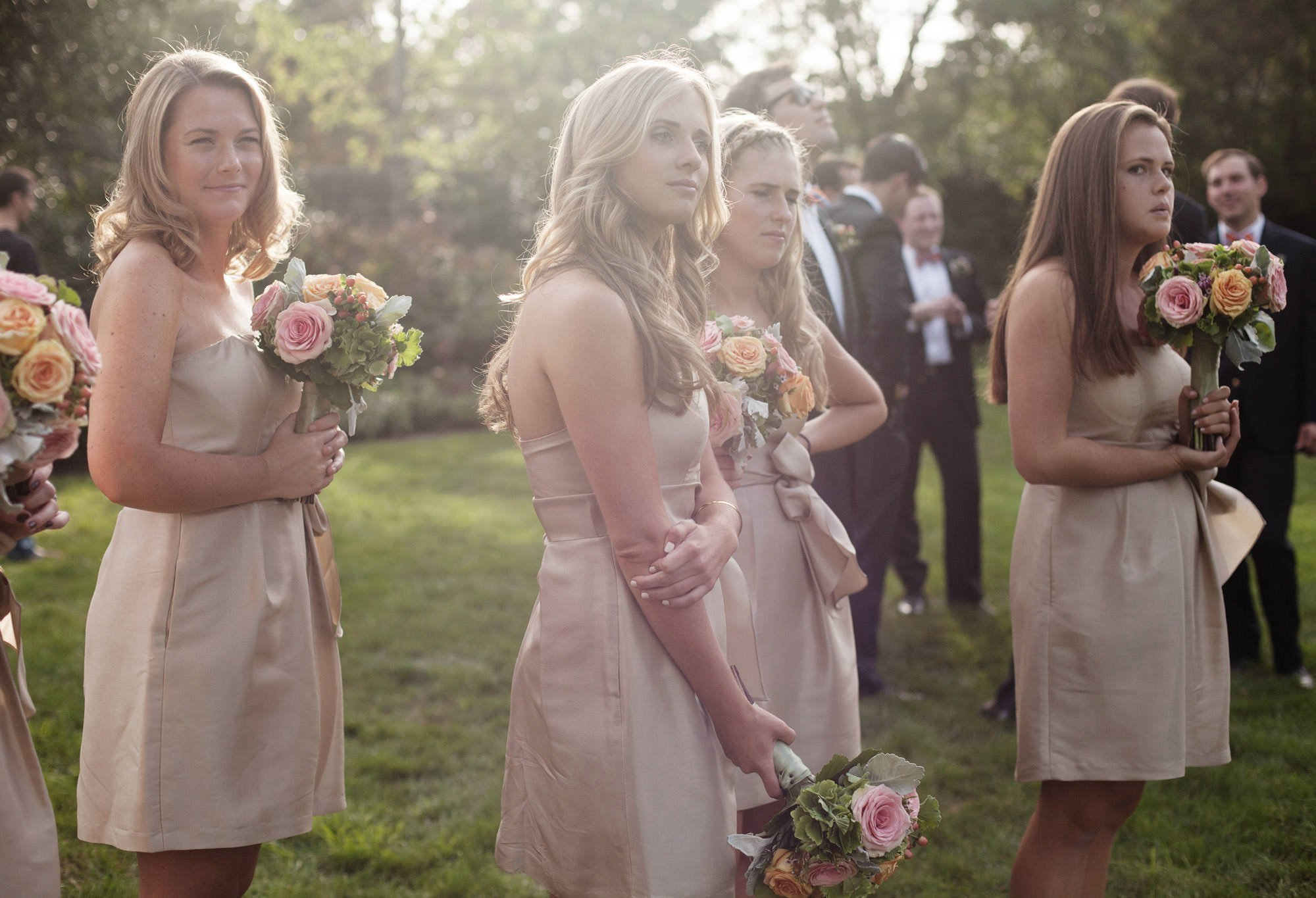 Bridesmaids wait for the portraits to begin following the wedding ceremony at Washington National Cathedral.