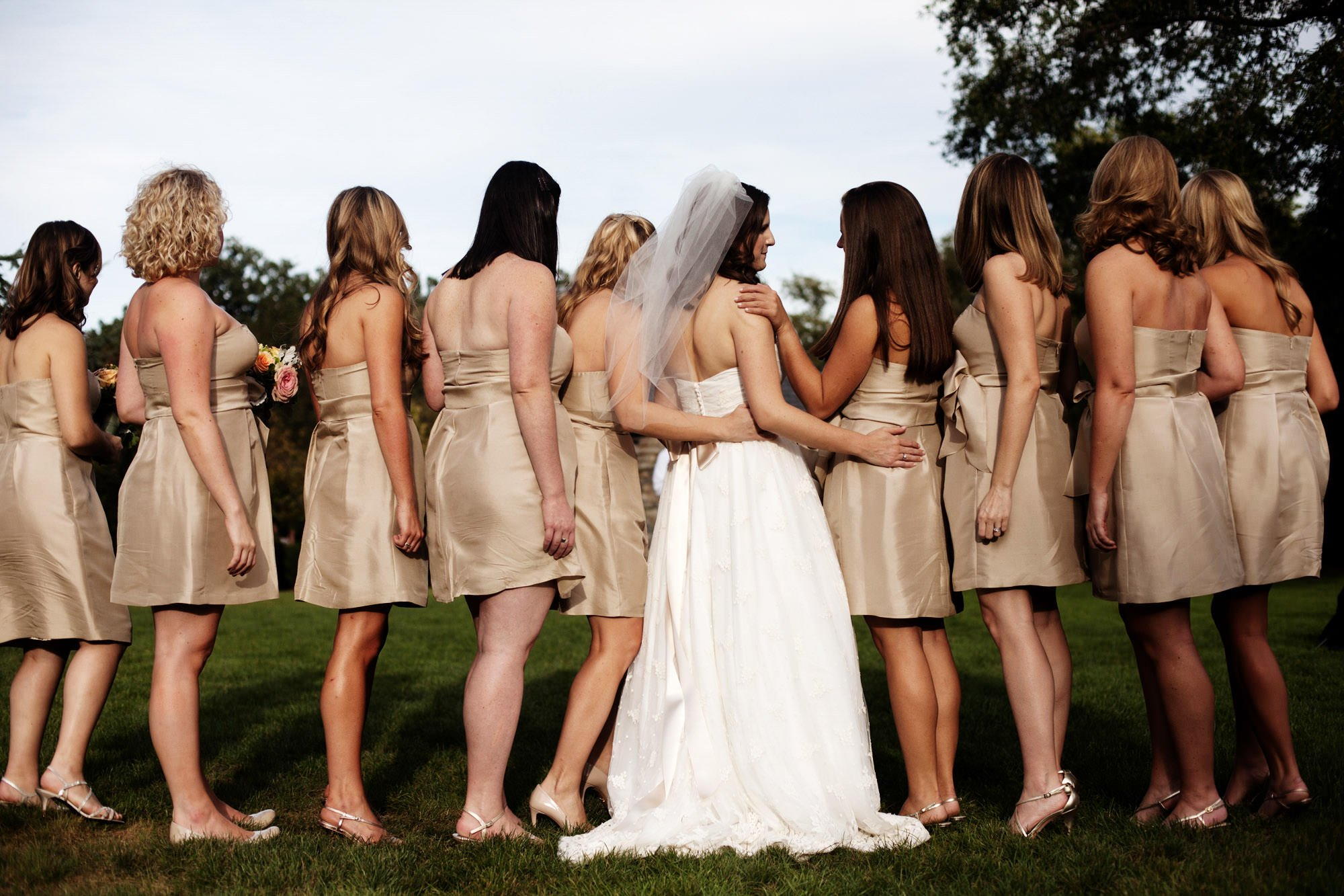 Bridesmaids pose for portraits in the flower garden after the Washington National Cathedral wedding ceremony.