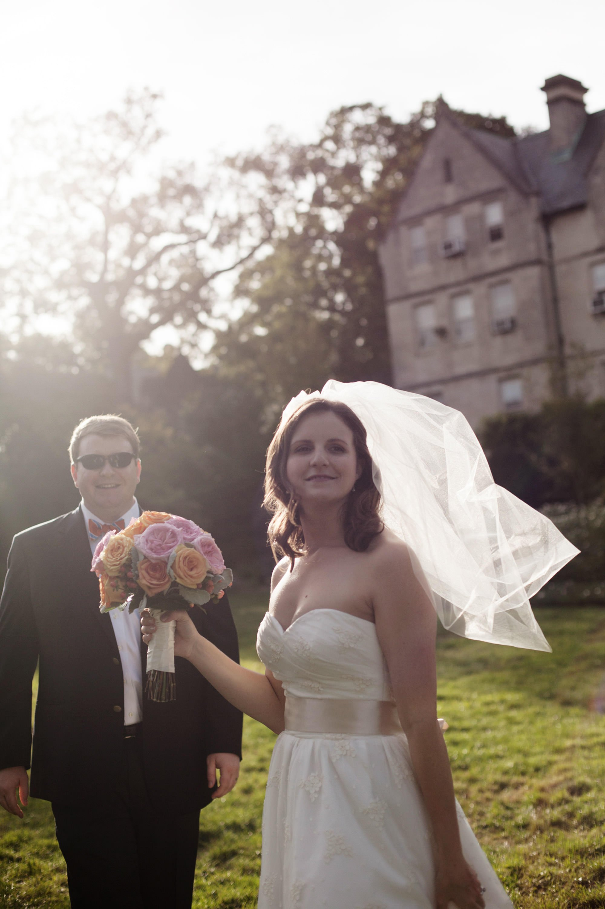 The bride stands in the flower garden following her Washington National Cathedral wedding ceremony.