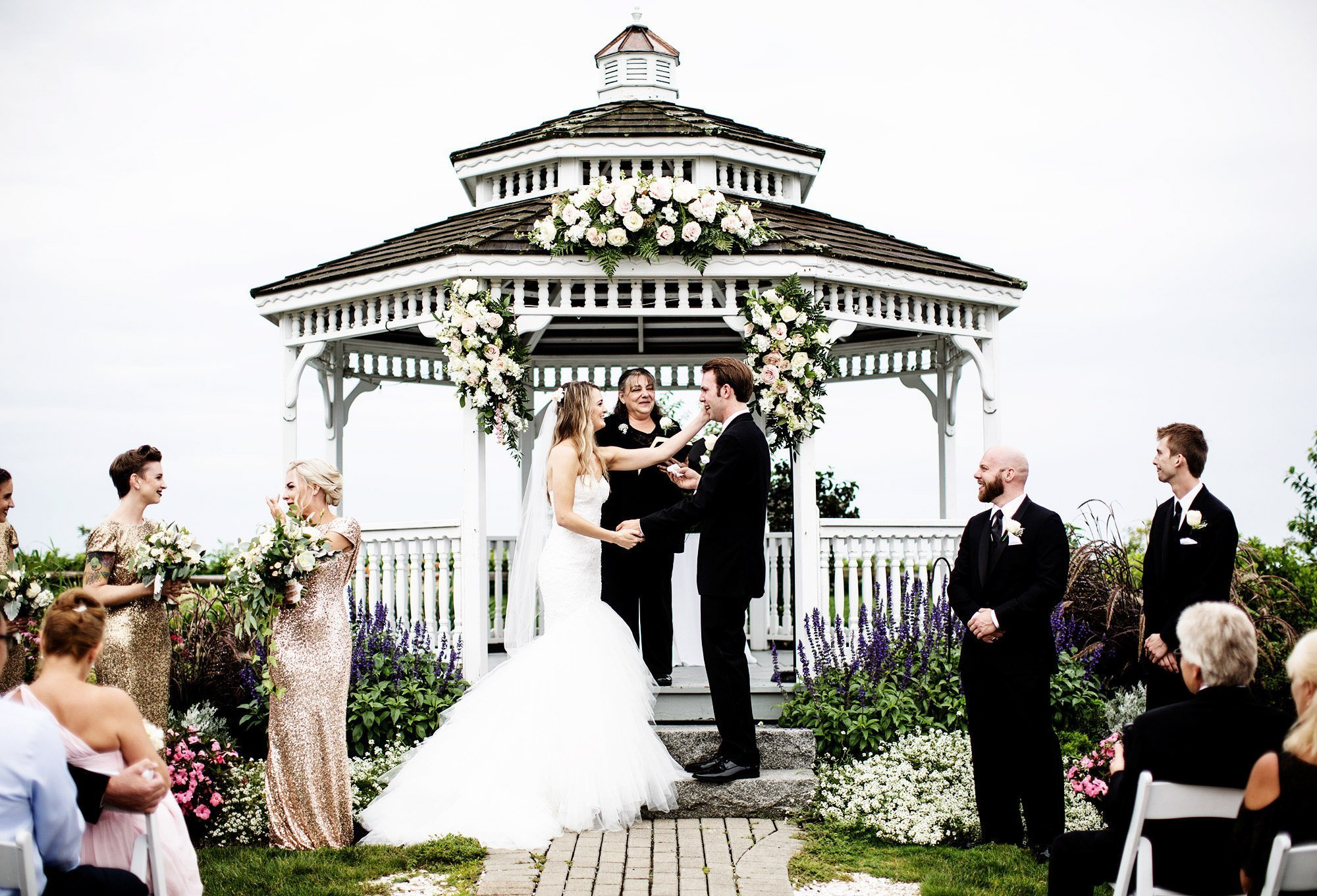 The bride and groom participate in their ceremony during their White Cliffs Country Club Wedding.