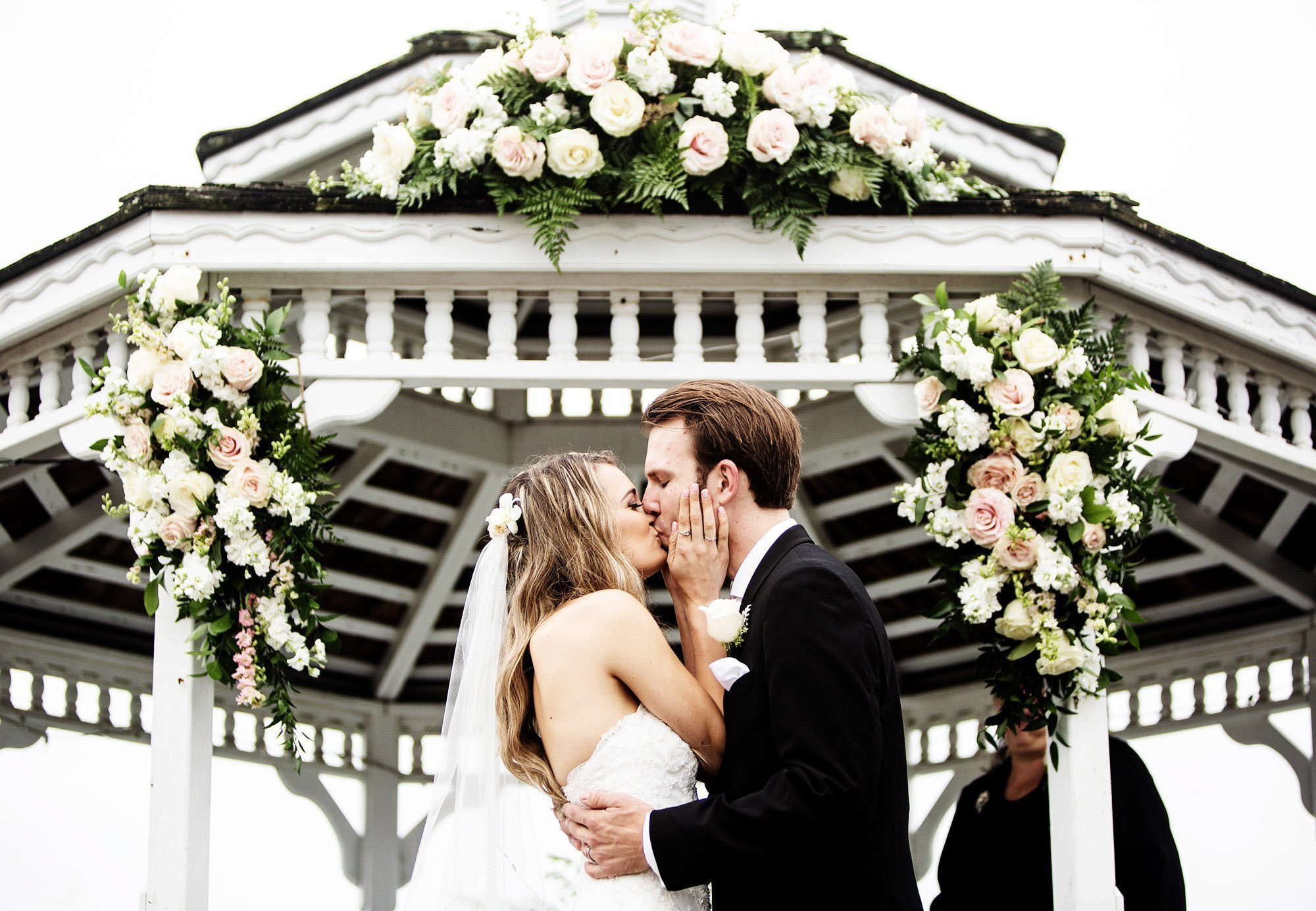 The couple share their first kiss during the White Cliffs Country Club Wedding ceremony.