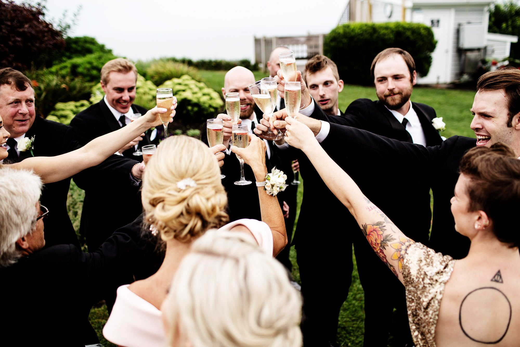 The wedding party toasts following the White Cliffs Country Club Wedding ceremony.