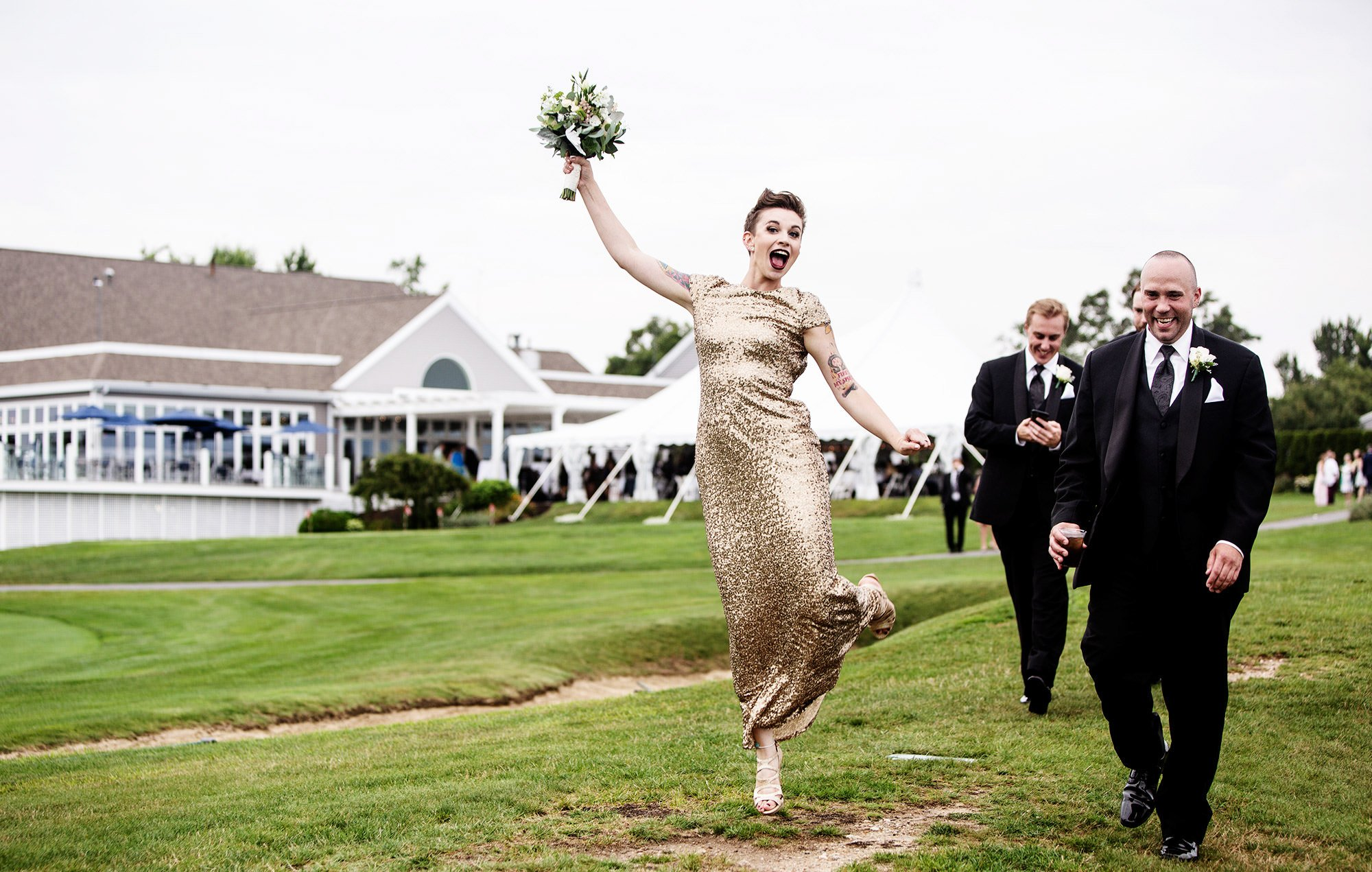 The wedding party celebrates following the White Cliffs Country Club wedding ceremony.