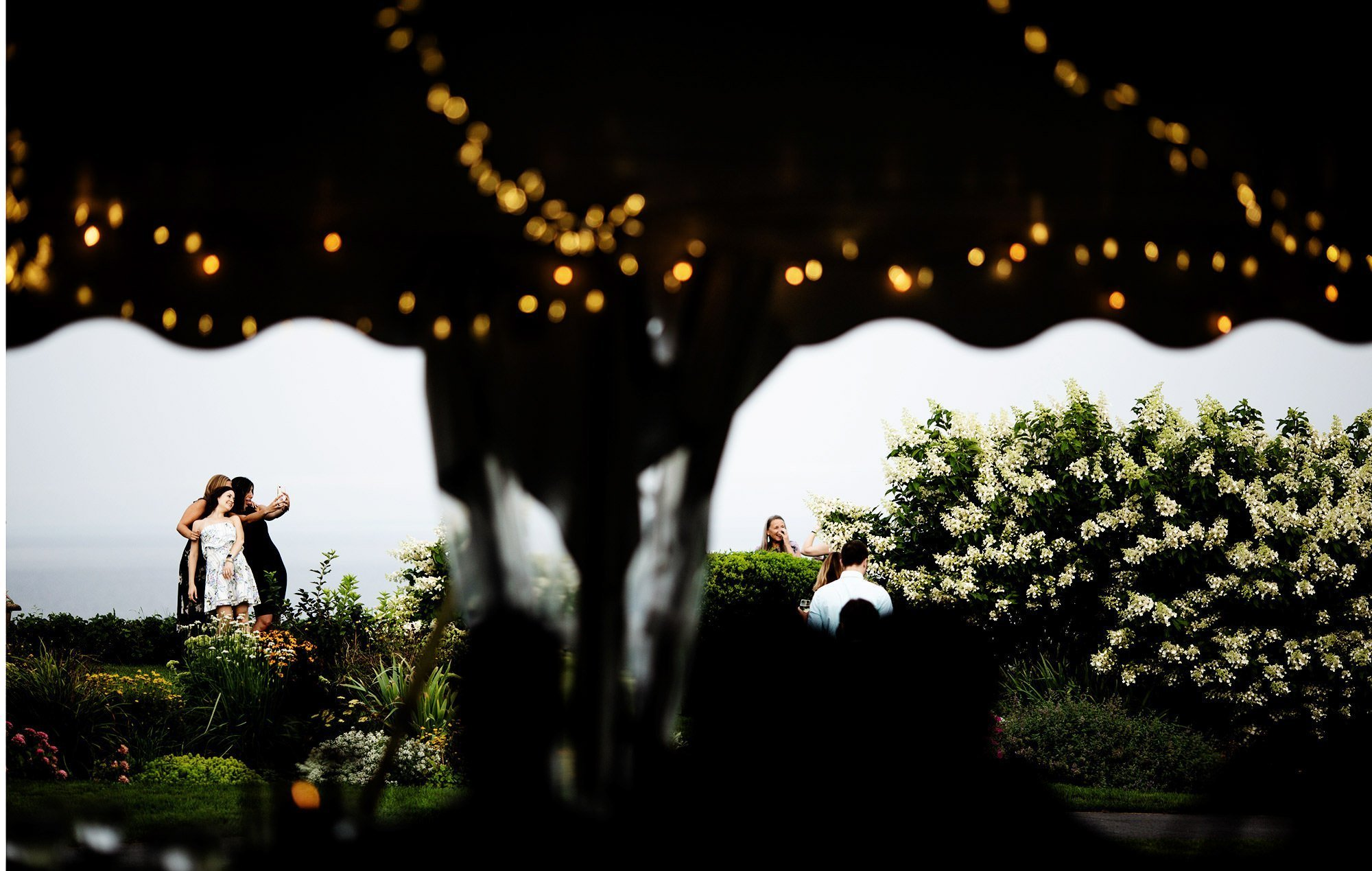Guests enjoy cocktail hour on this White Cliffs Country Club wedding day.