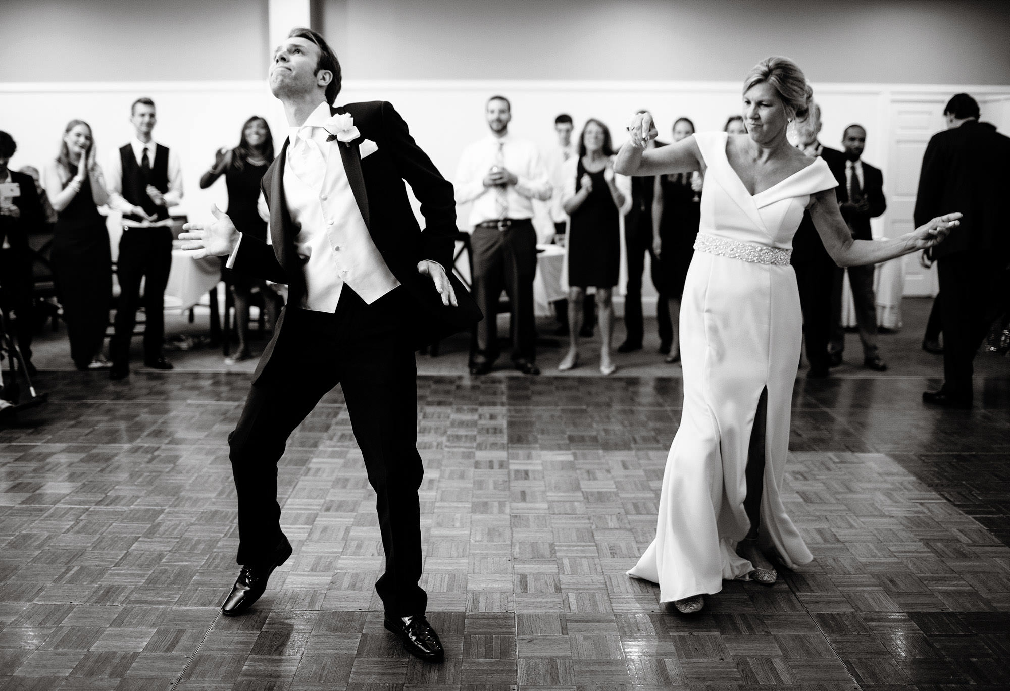 The groom dances with his mother during the White Cliffs Country Club wedding reception.