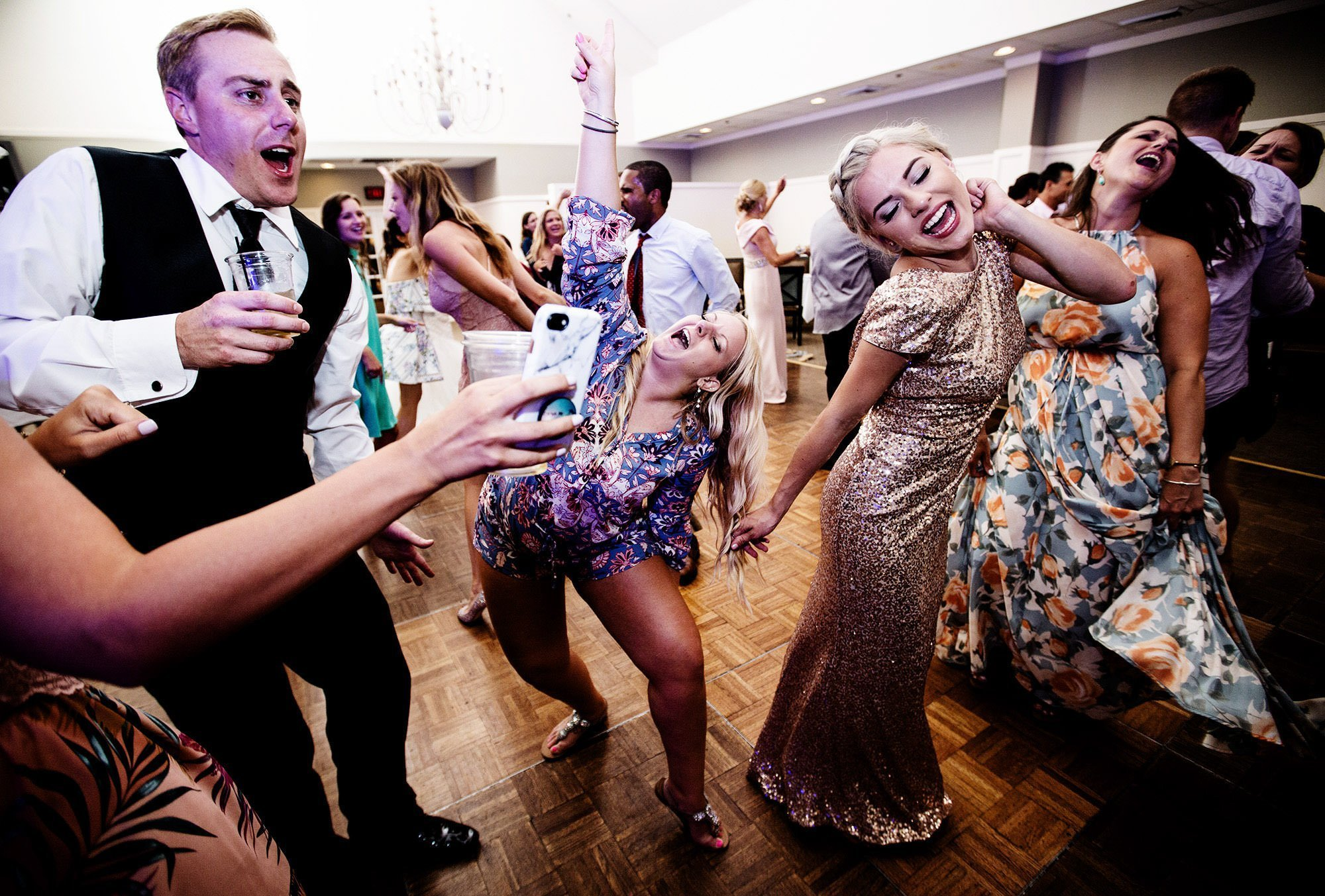 Guests dance during the White Cliffs Country Club wedding reception.