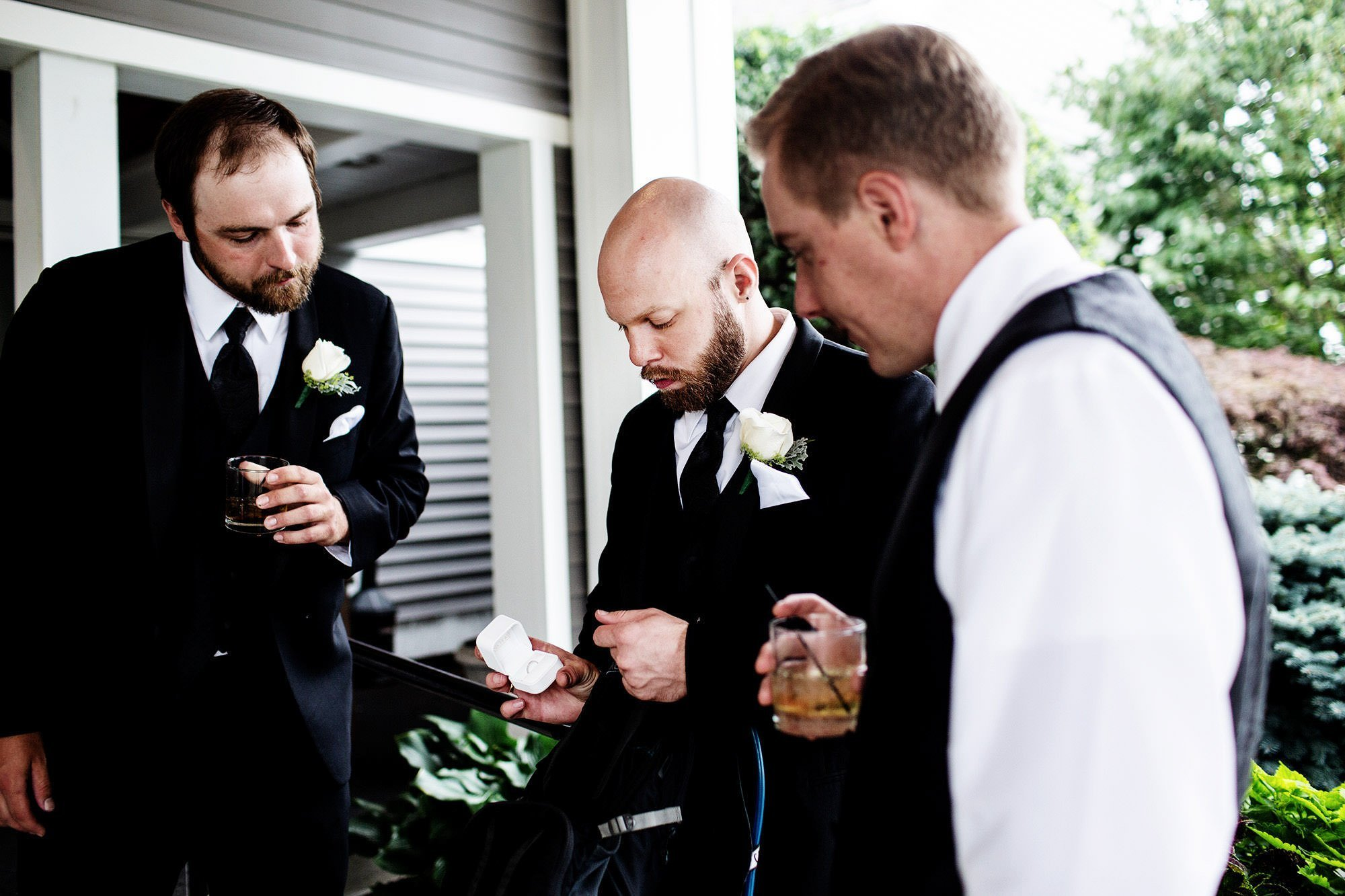 The groomsmen check out the wedding rings during this White Cliffs Country Club Wedding.