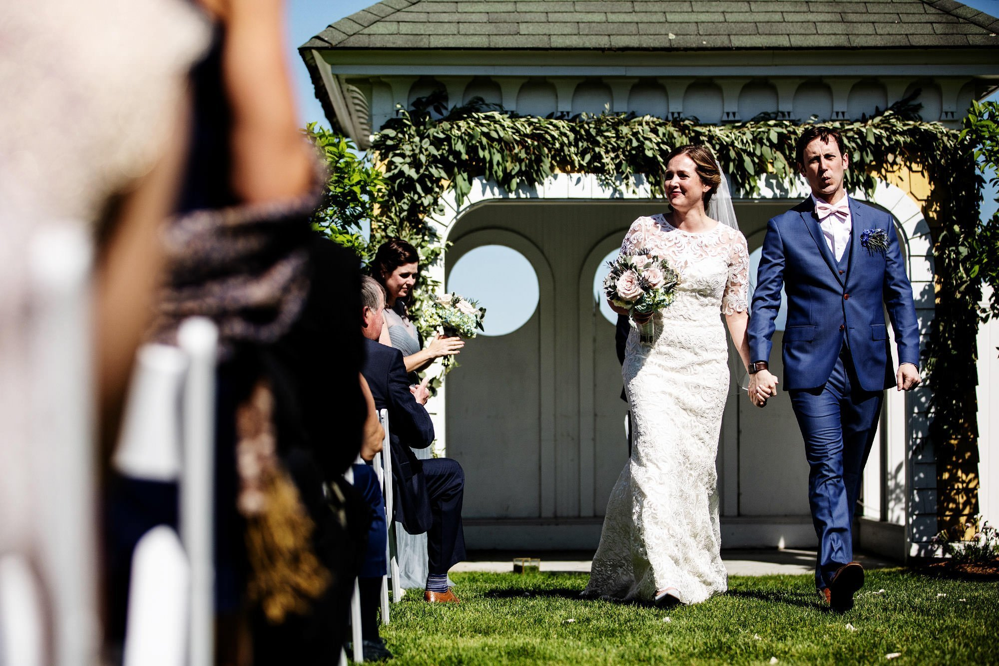 The couple walk down the aisle during the Mountain View Grand Wedding ceremony.