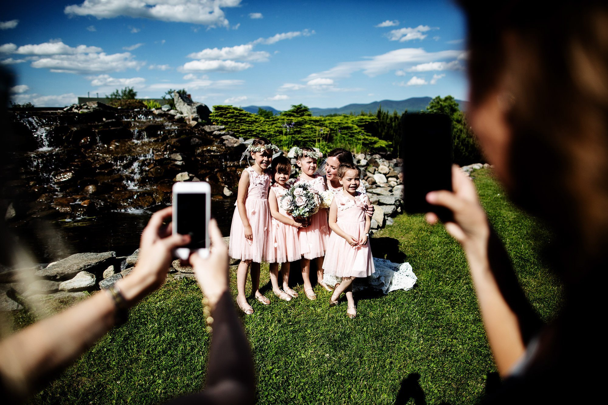 The bride poses with her flower girls on her Mountain View Grand Wedding day in the White Mountains.