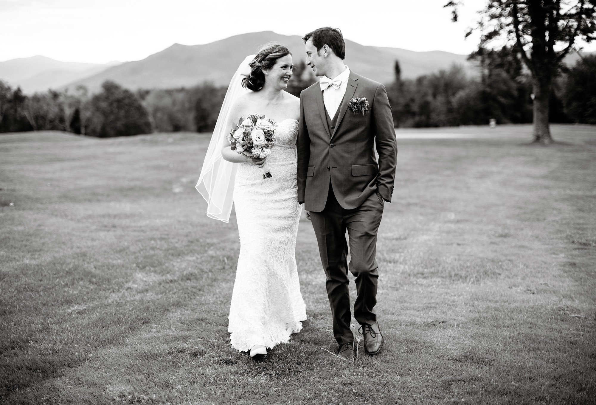 The bride and groom stroll along the grounds on their Mountain View Grand Wedding day in the White Mountains.