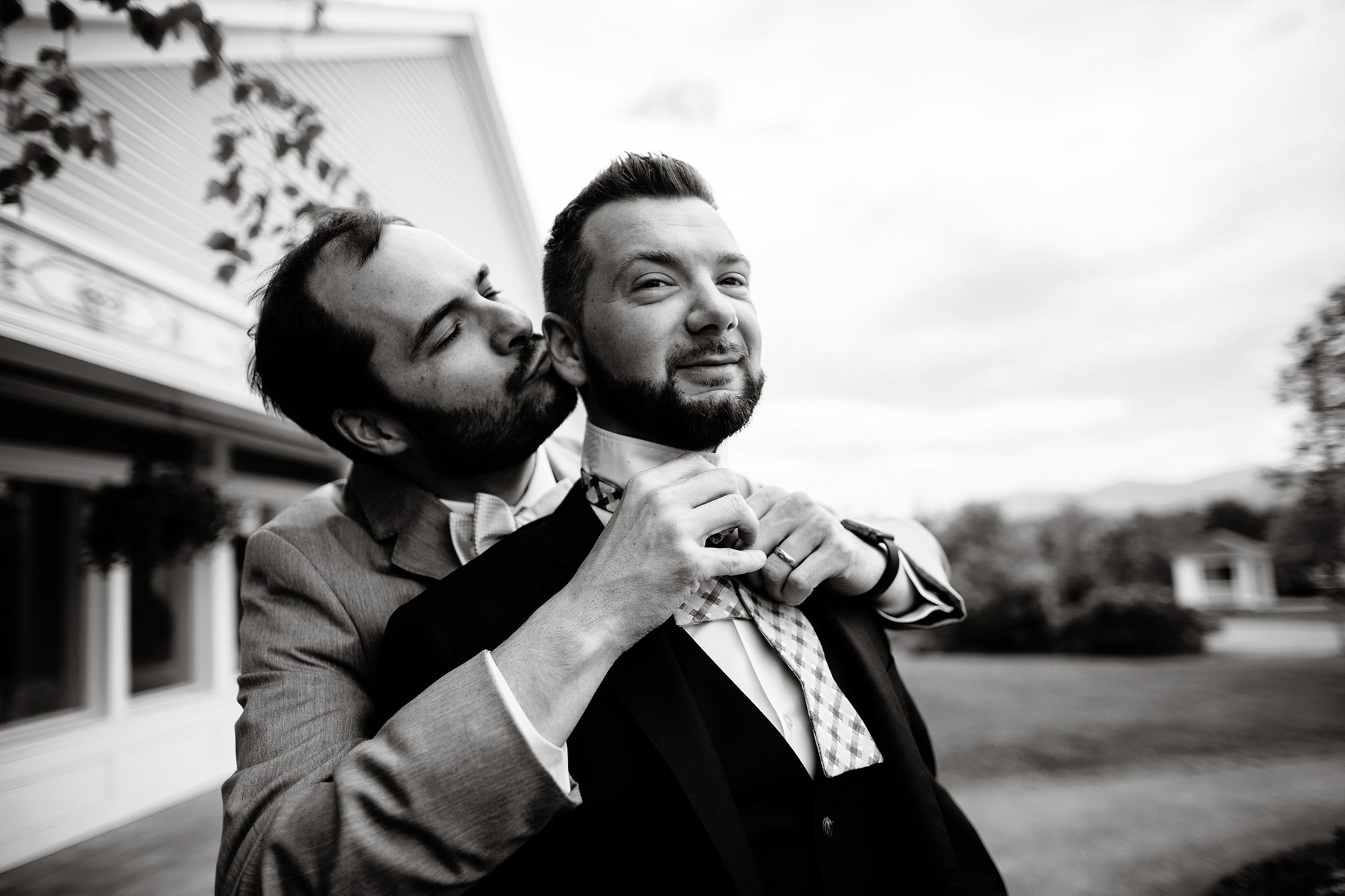 Groomsmen put on their bowties on the Mountain View Grand Wedding day.