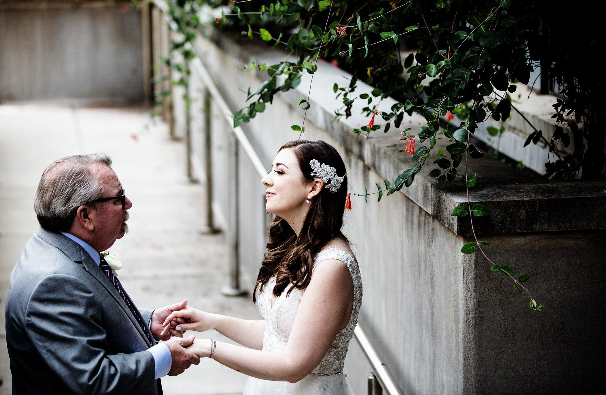The bride shares a first look with her dad before the wedding ceremony at American Institute of Architects.