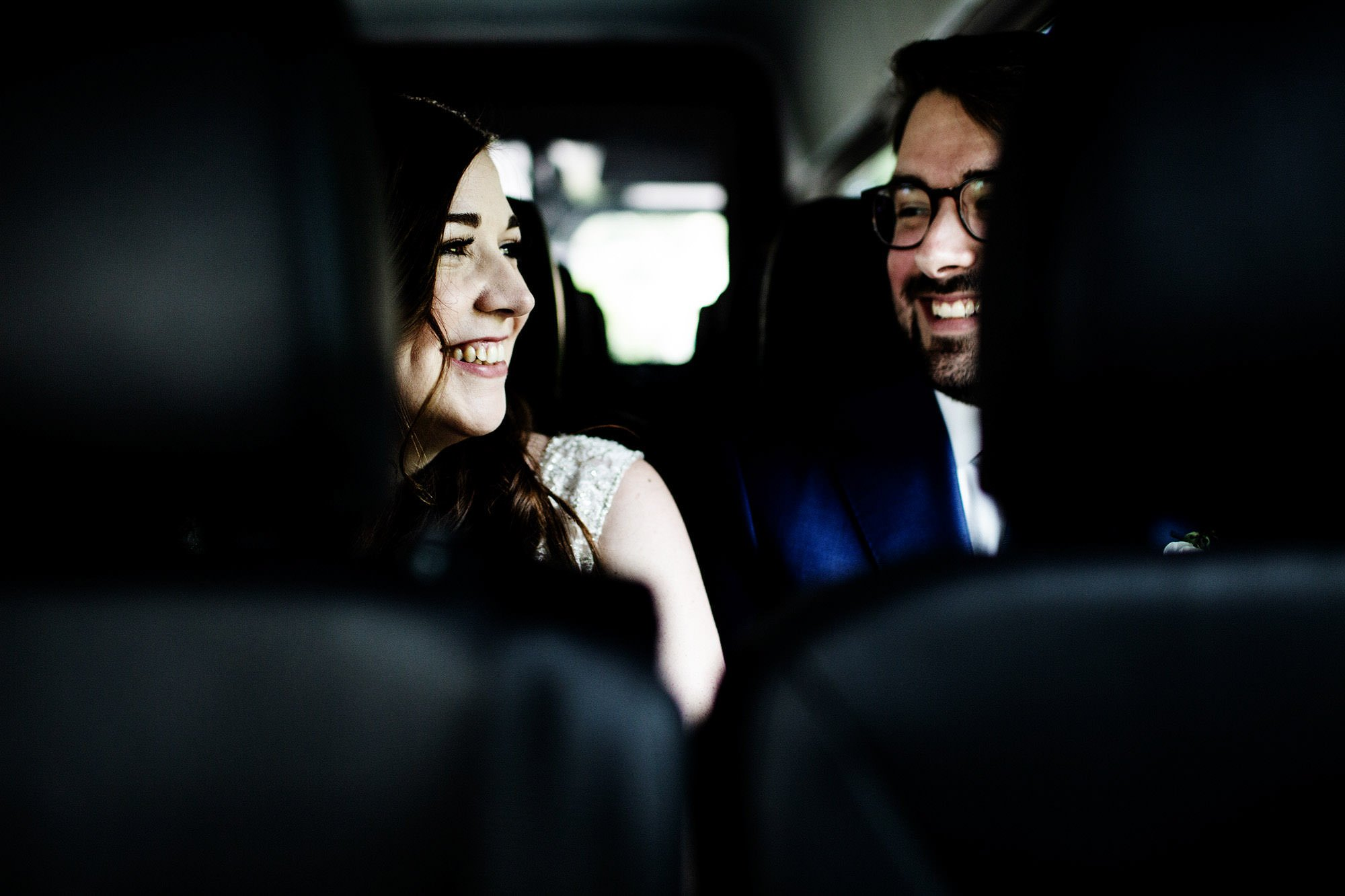 The couple ride in a shuttle to their wedding ceremony at American Institute of Architects.