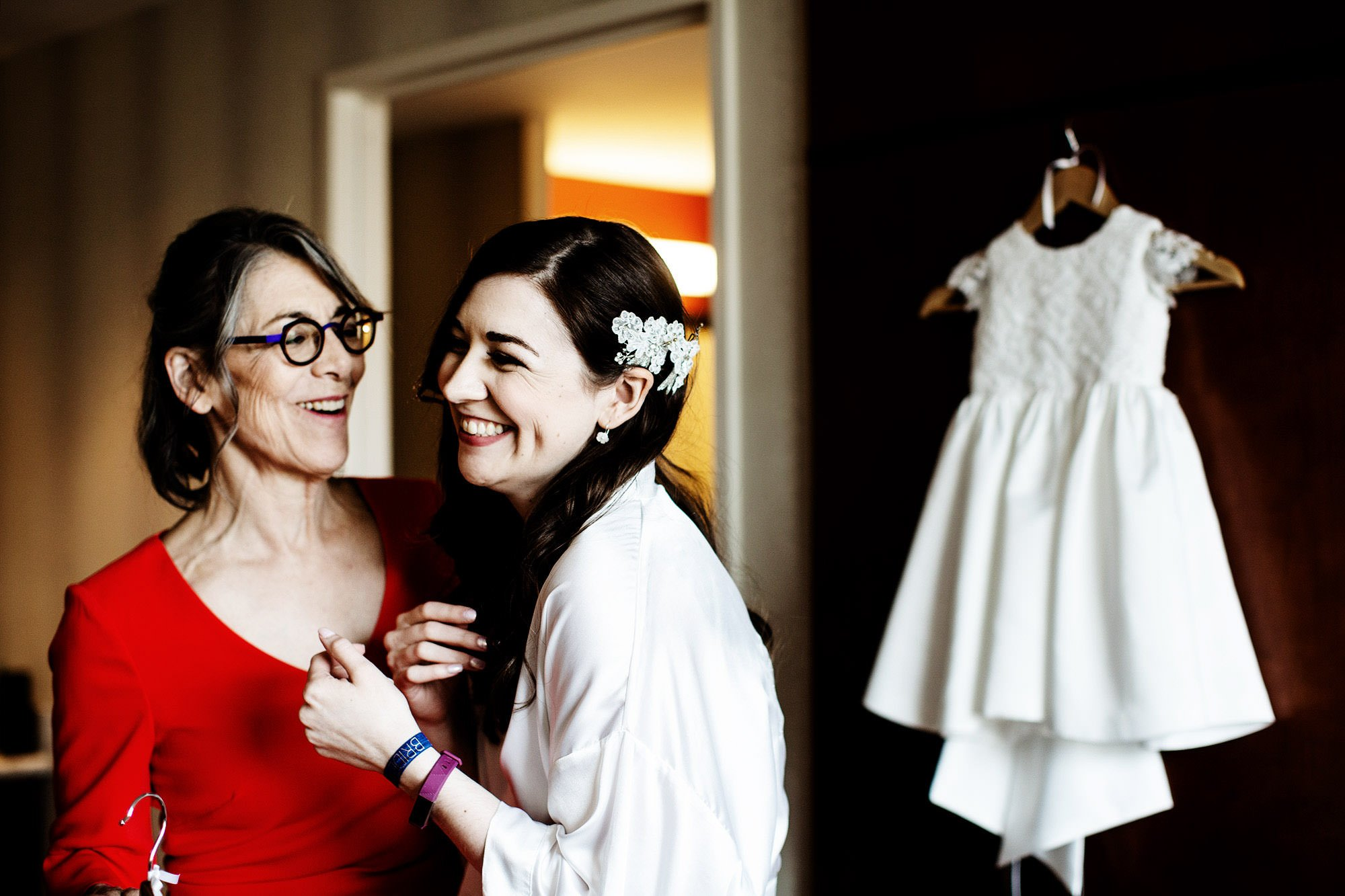 The bride laughs with her mother before her American Institute of Architects Wedding.