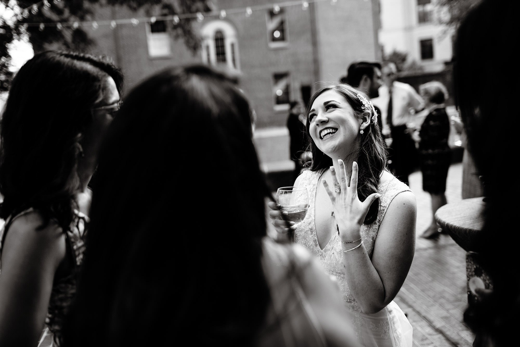 The bride shows off her wedding ring following the ceremony at American Institute of Architects in Washington, DC.