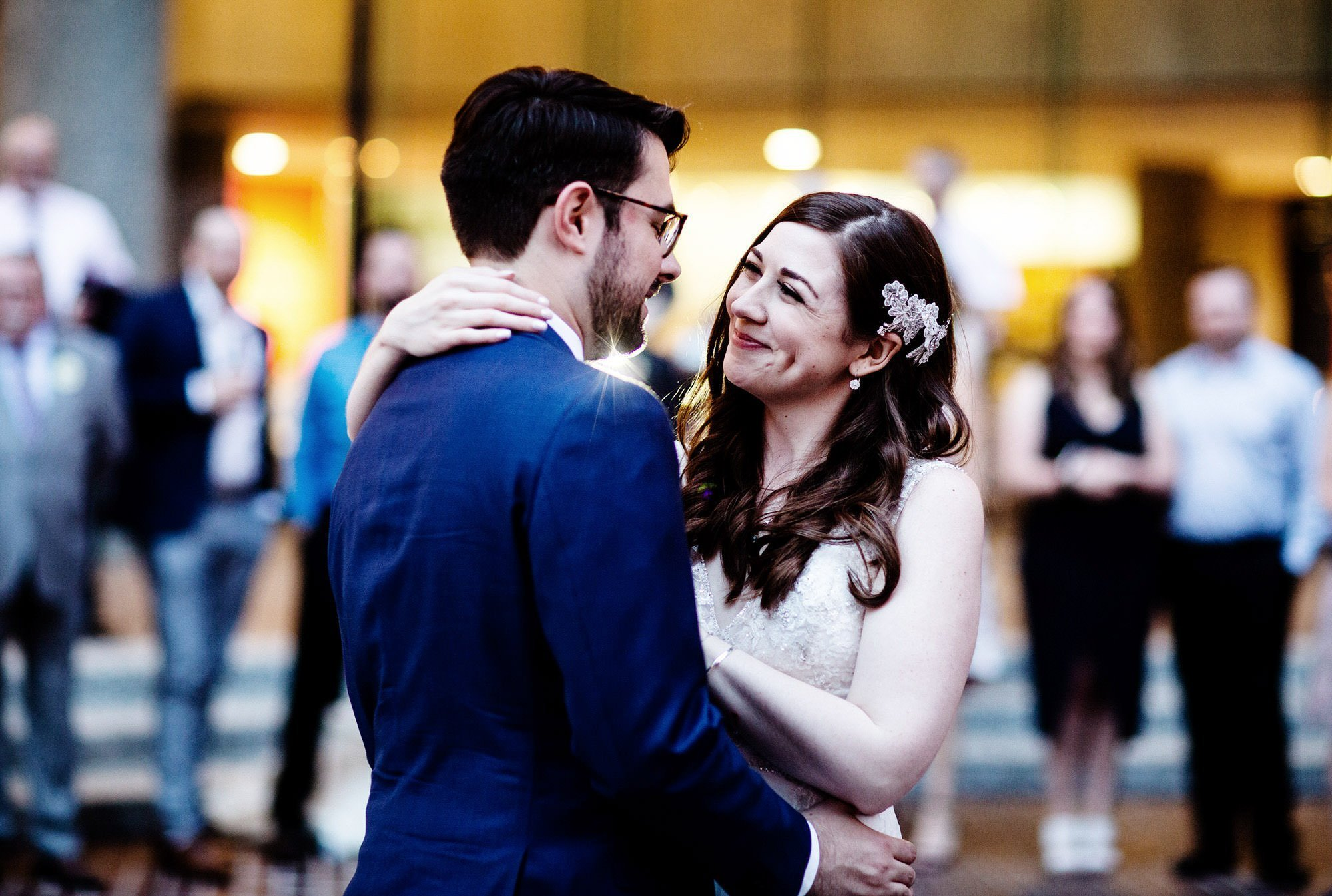 The bride and groom share their first dance on their American Institute of Architects Wedding day.
