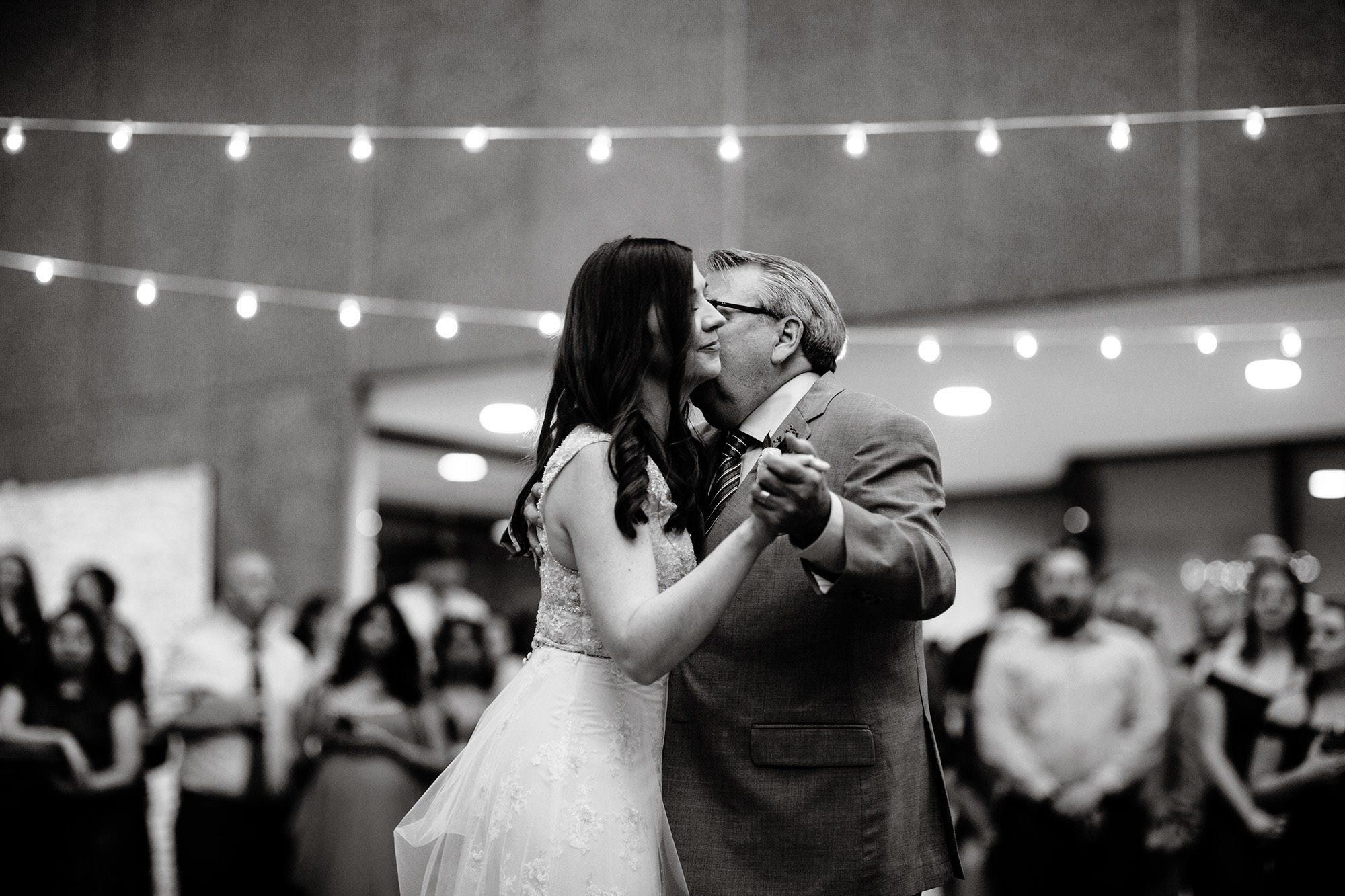 The bride dances with her father during the American Institute of Architects wedding reception.