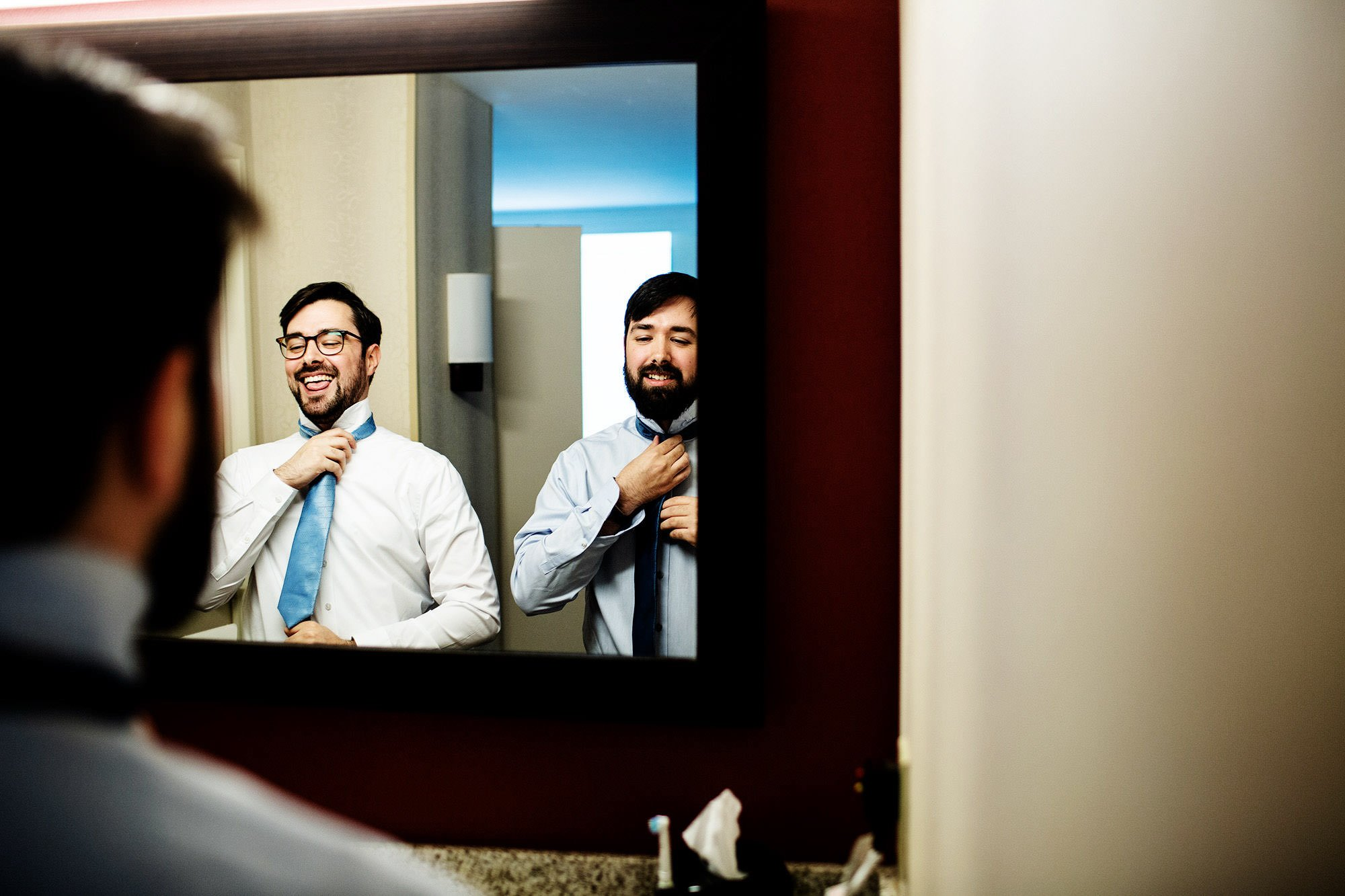 The groom and his best man put on their ties prior to the American Institute of Architects Wedding ceremony.