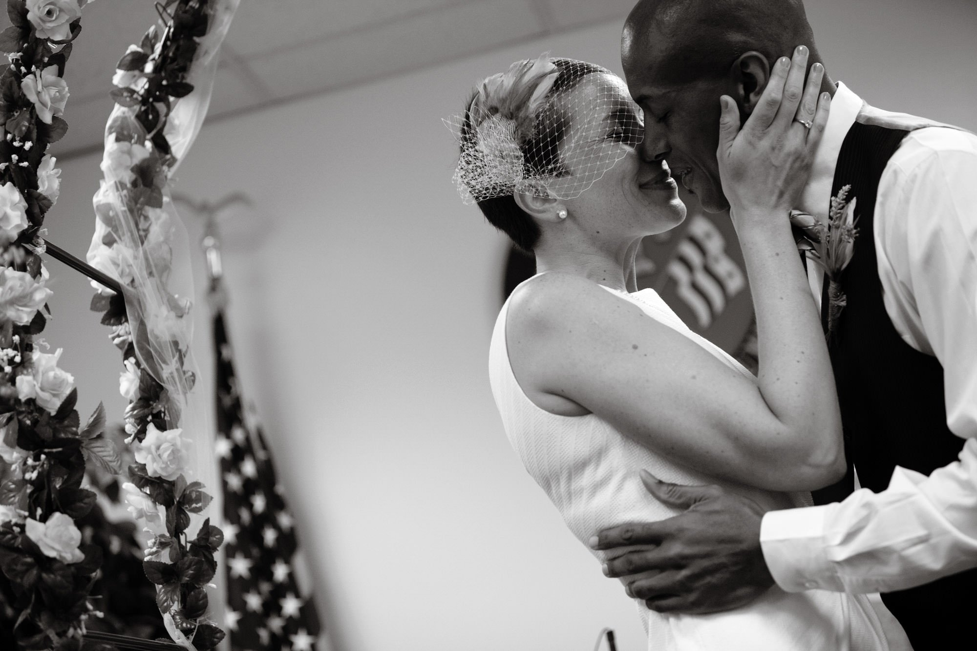 The bride and groom kiss during the DC Courthouse wedding ceremony.