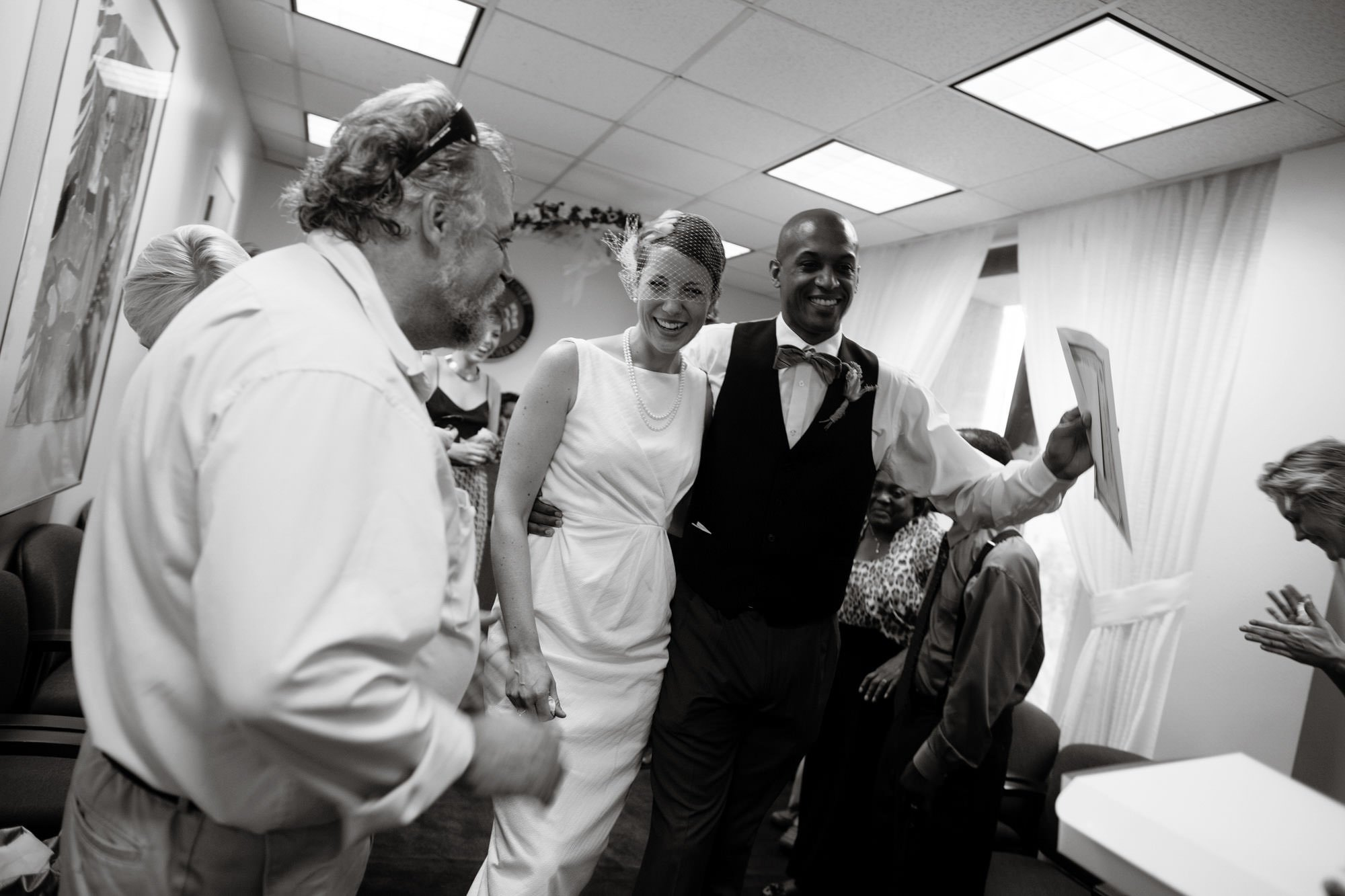 The couple processes down the aisle as a married couple following their DC Courthouse wedding ceremony.