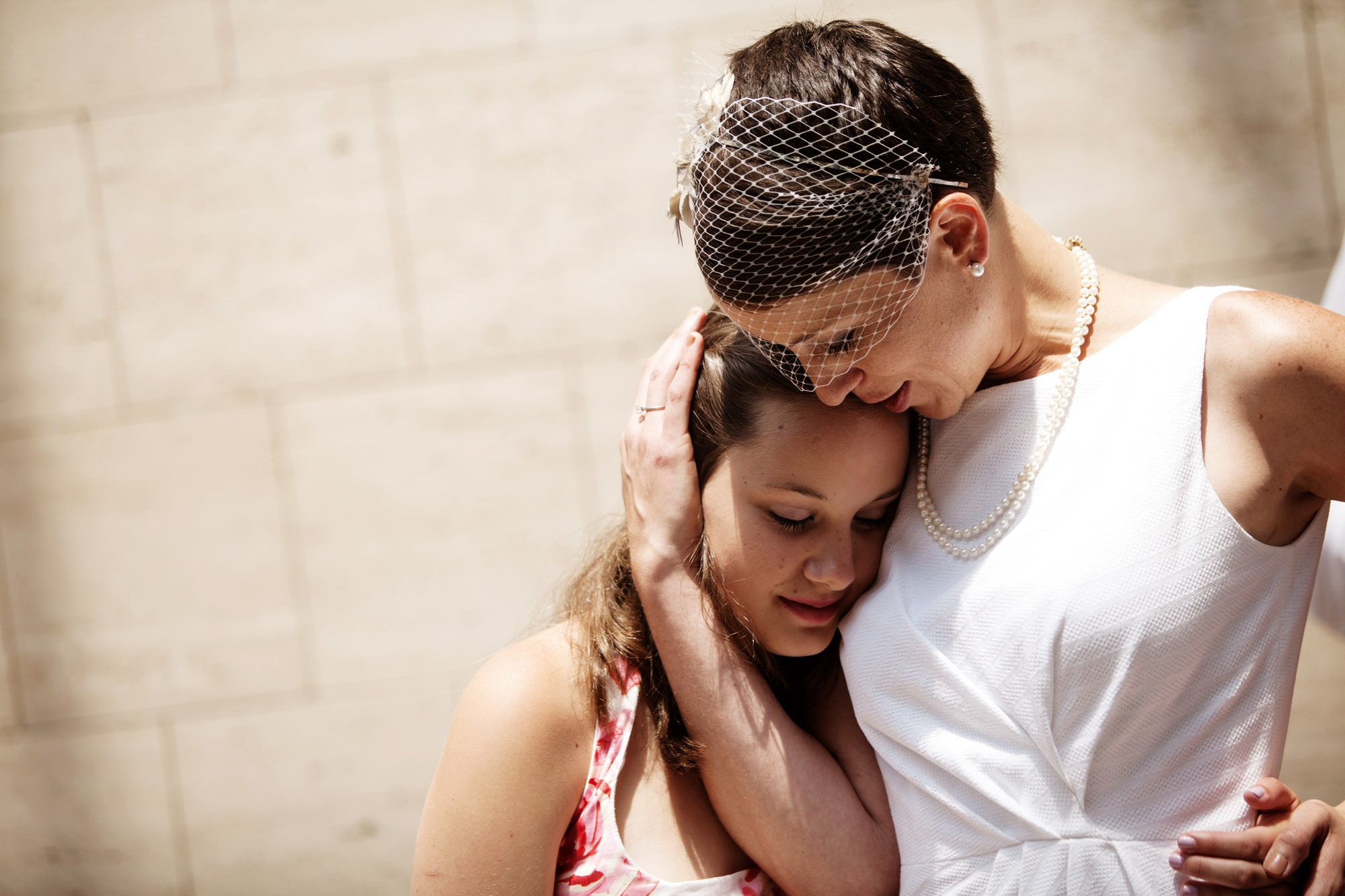 The bride hugs her sister following the DC Courthouse wedding ceremony.