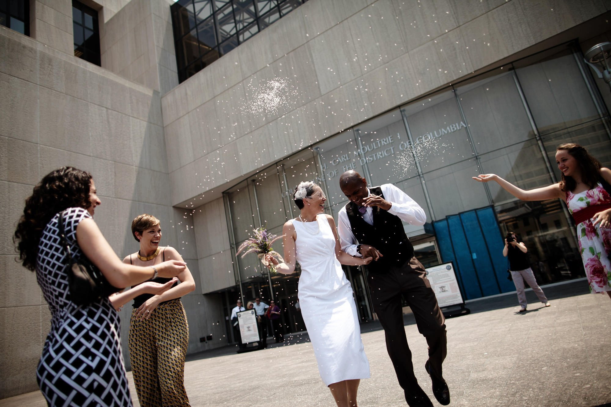 The bride and groom celebrate with their guests following their DC Courthouse wedding ceremony.