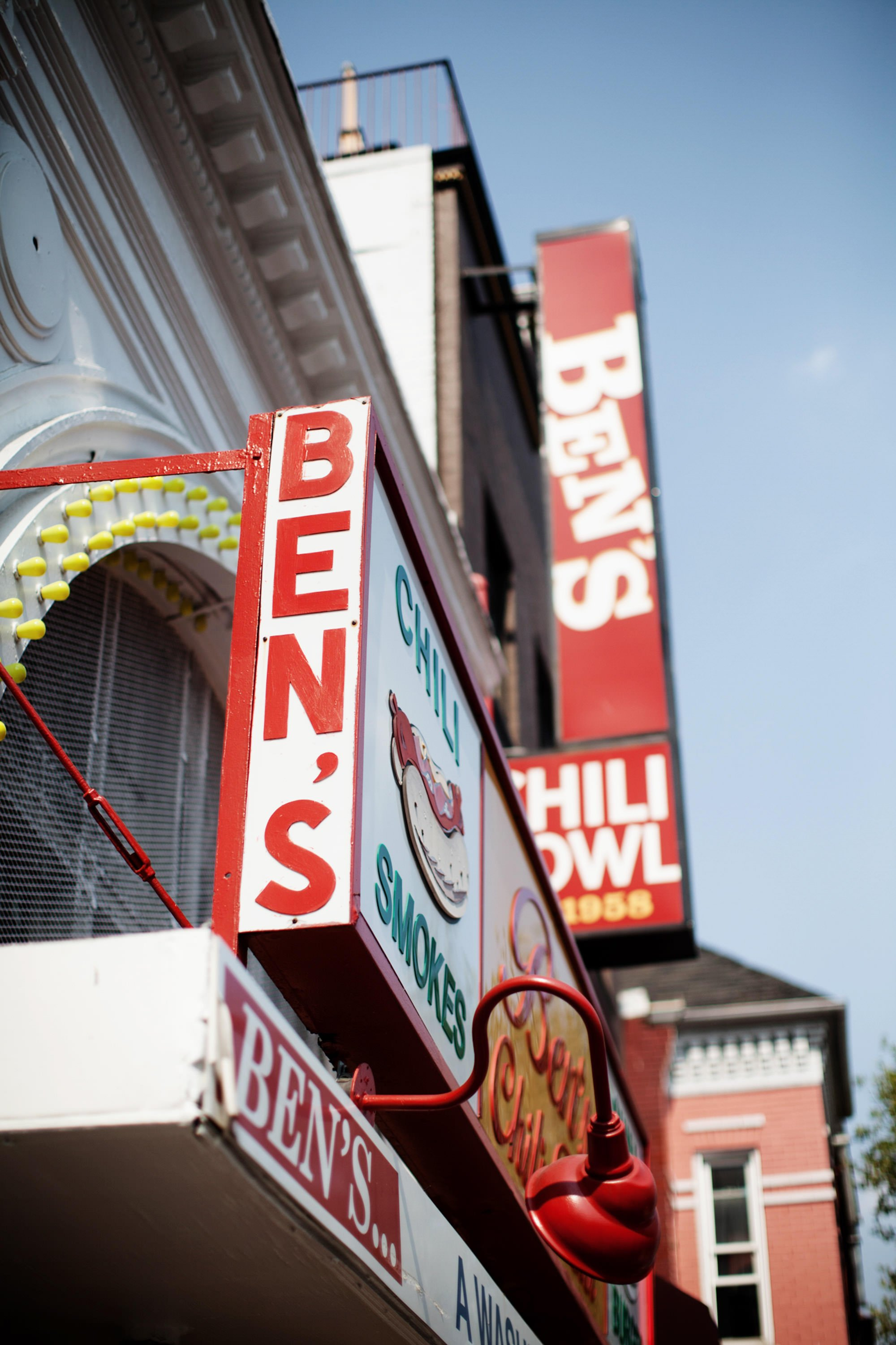 Following their DC Courthouse wedding ceremony, the bride and groom cerebrate at Ben's Chili Bowl.