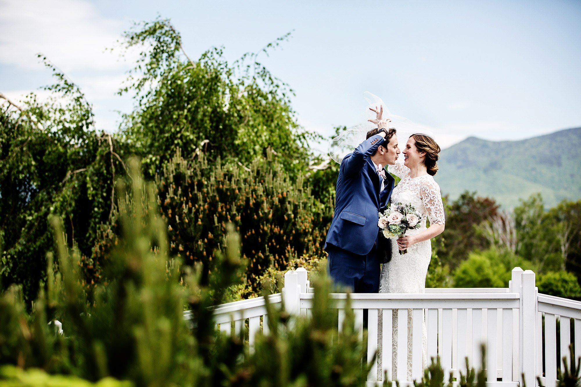 With the White Mountains in the background, the bride and groom share their First Look on their Mountain View Grand Wedding day.