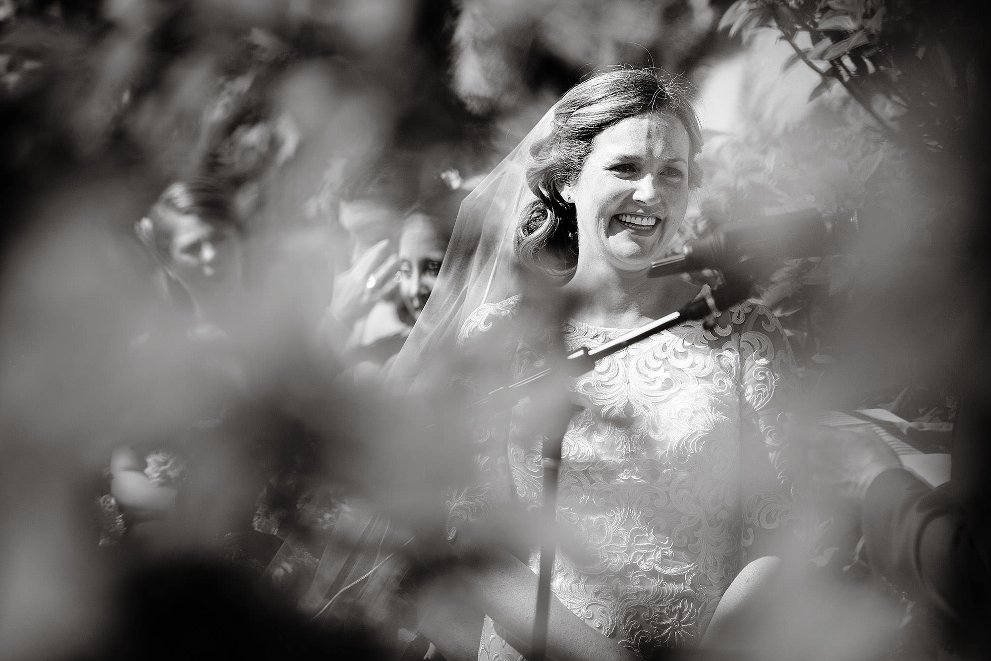 The bride smiles during the Mountain View Grand Wedding ceremony.