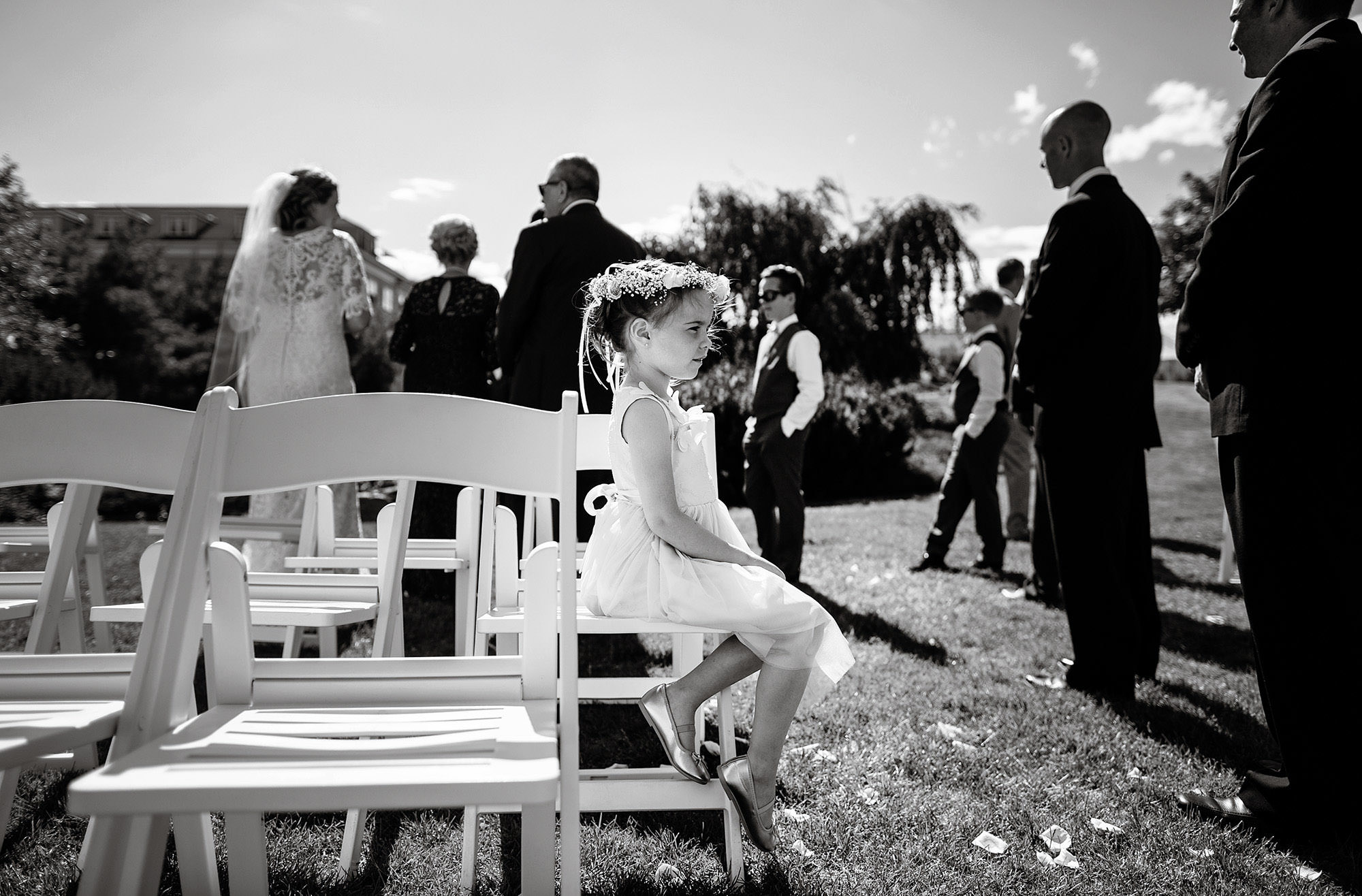Mountain View Grand Wedding  I  A flower girl sits following the White Mountains wedding ceremony.