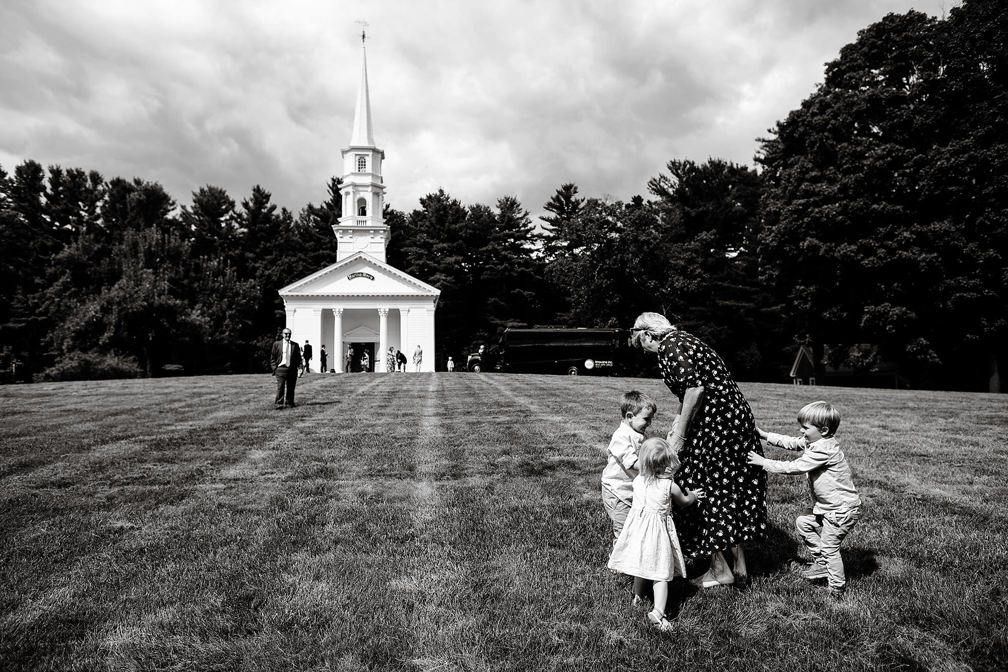 Martha Mary Chapel Wedding  I  Wedding guests play on the front lawn before the ceremony.