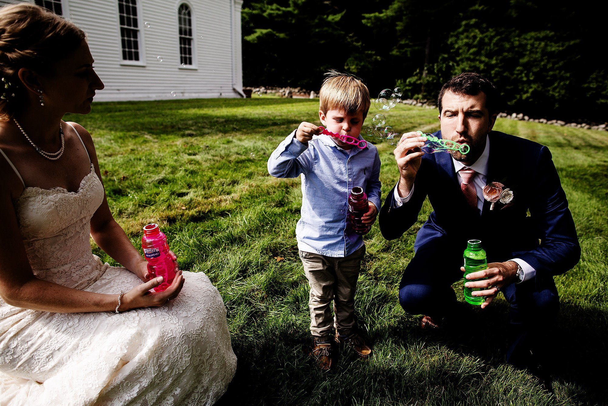 Martha Mary Chapel Wedding  I  The groom blows bubbles with a little boy.