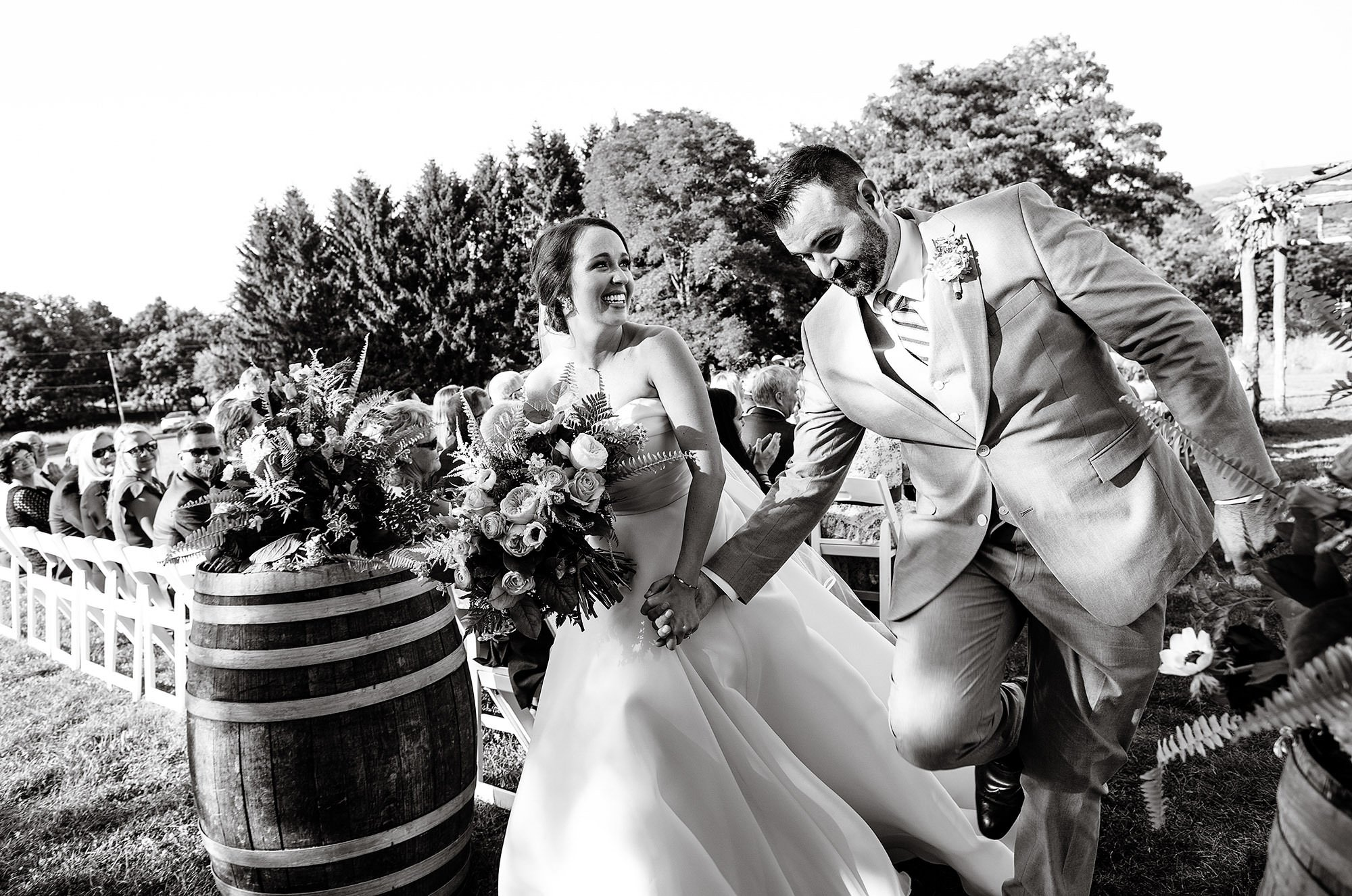 Red Maple Vineyard Wedding  I  The couple walks down the aisle as husband and wife.