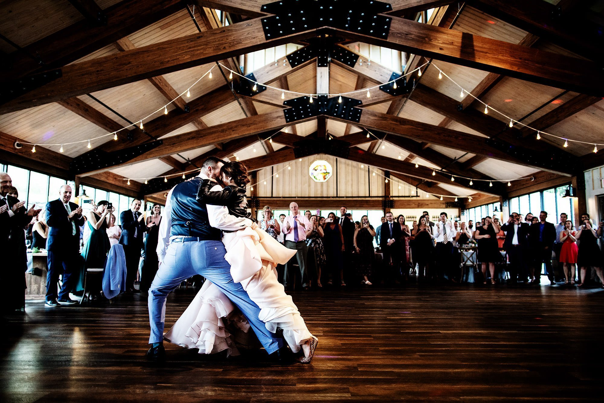 Red Maple Vineyard Wedding  I  The couple share their first dance in the barn of Red Maple Vineyard in Upstate New York.