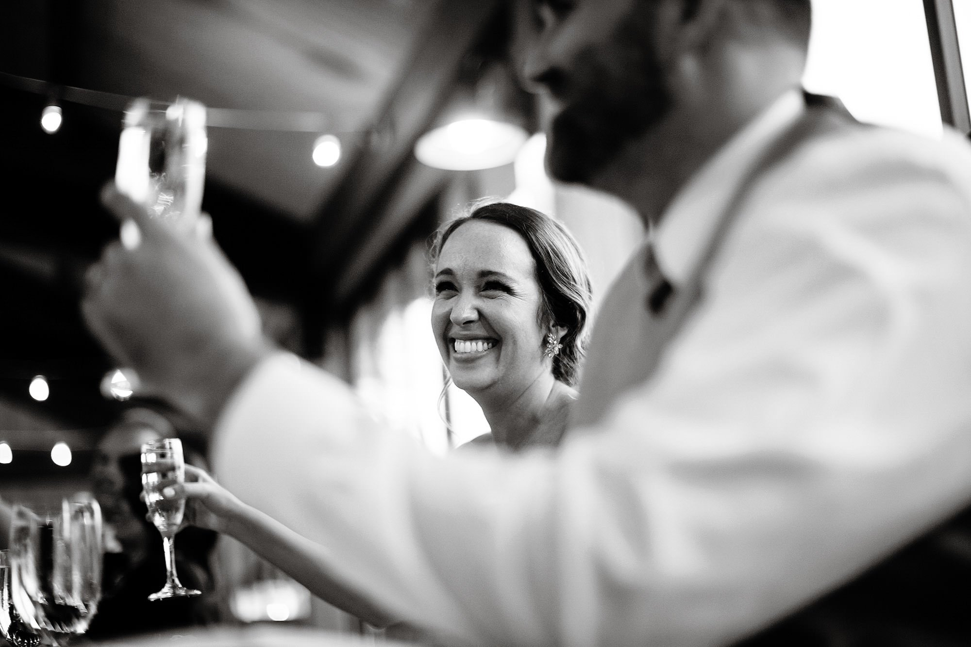 Red Maple Vineyard Wedding  I  The bride smiles during toasts.