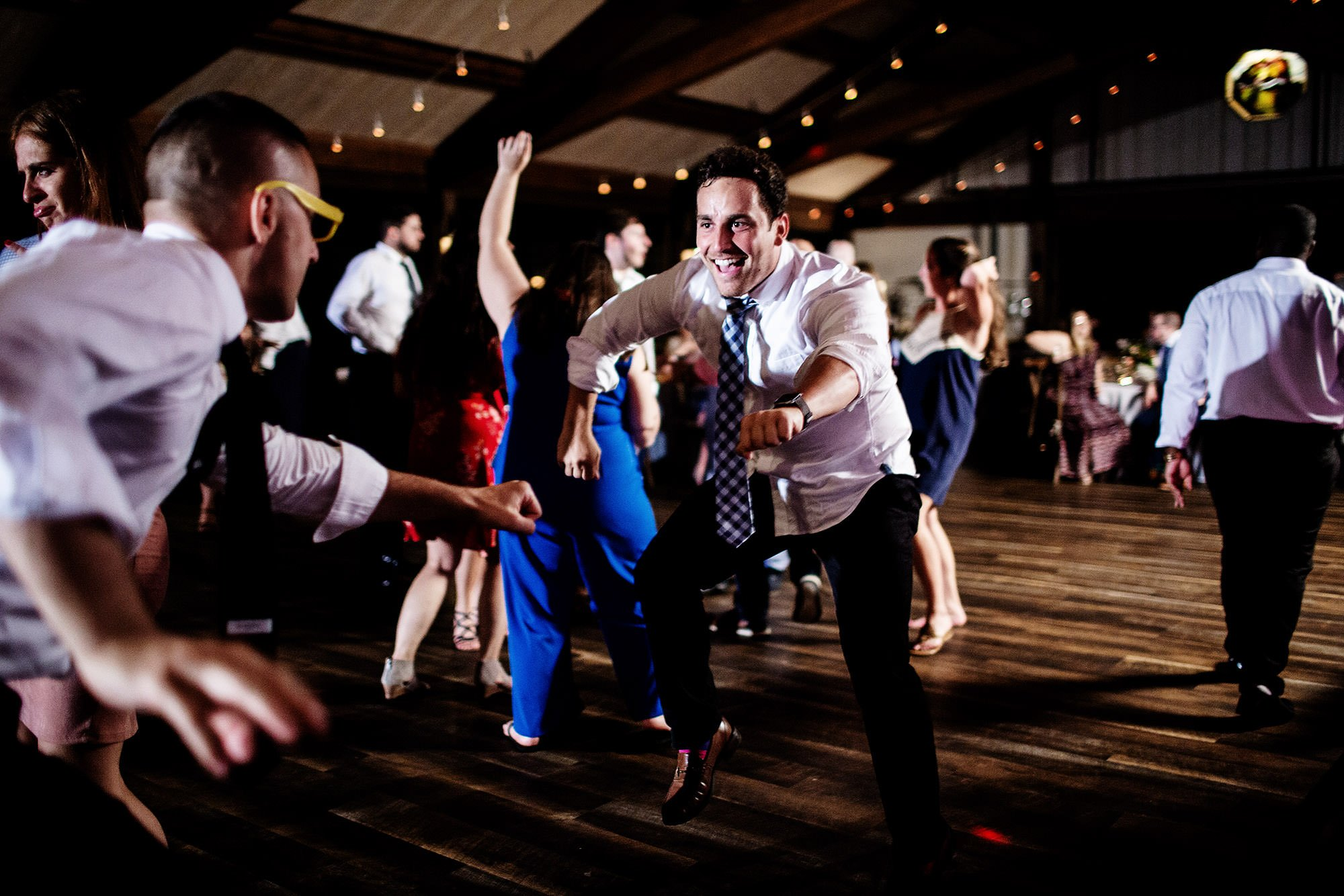 Red Maple Vineyard Wedding  I  Guests dance during the reception in Upstate New York.