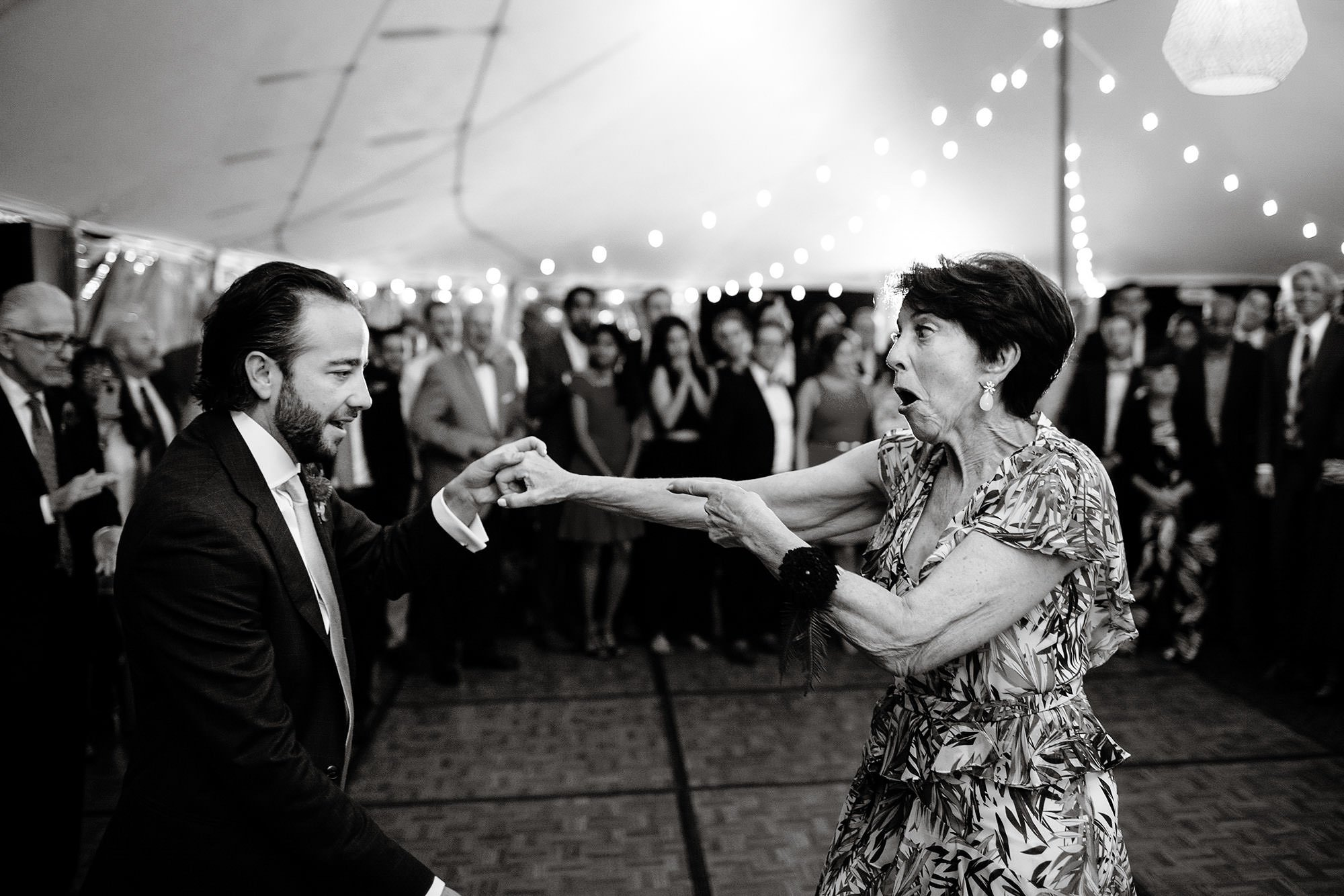 Chatham MA Wedding  I  Cape Cod Wedding  I  The groom dances with his mom during their tented wedding reception.