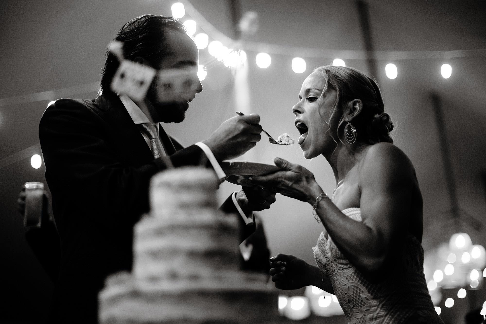 Chatham MA Wedding  I  Cape Cod Wedding  I  The bride and groom cut their wedding cake during their tented reception.