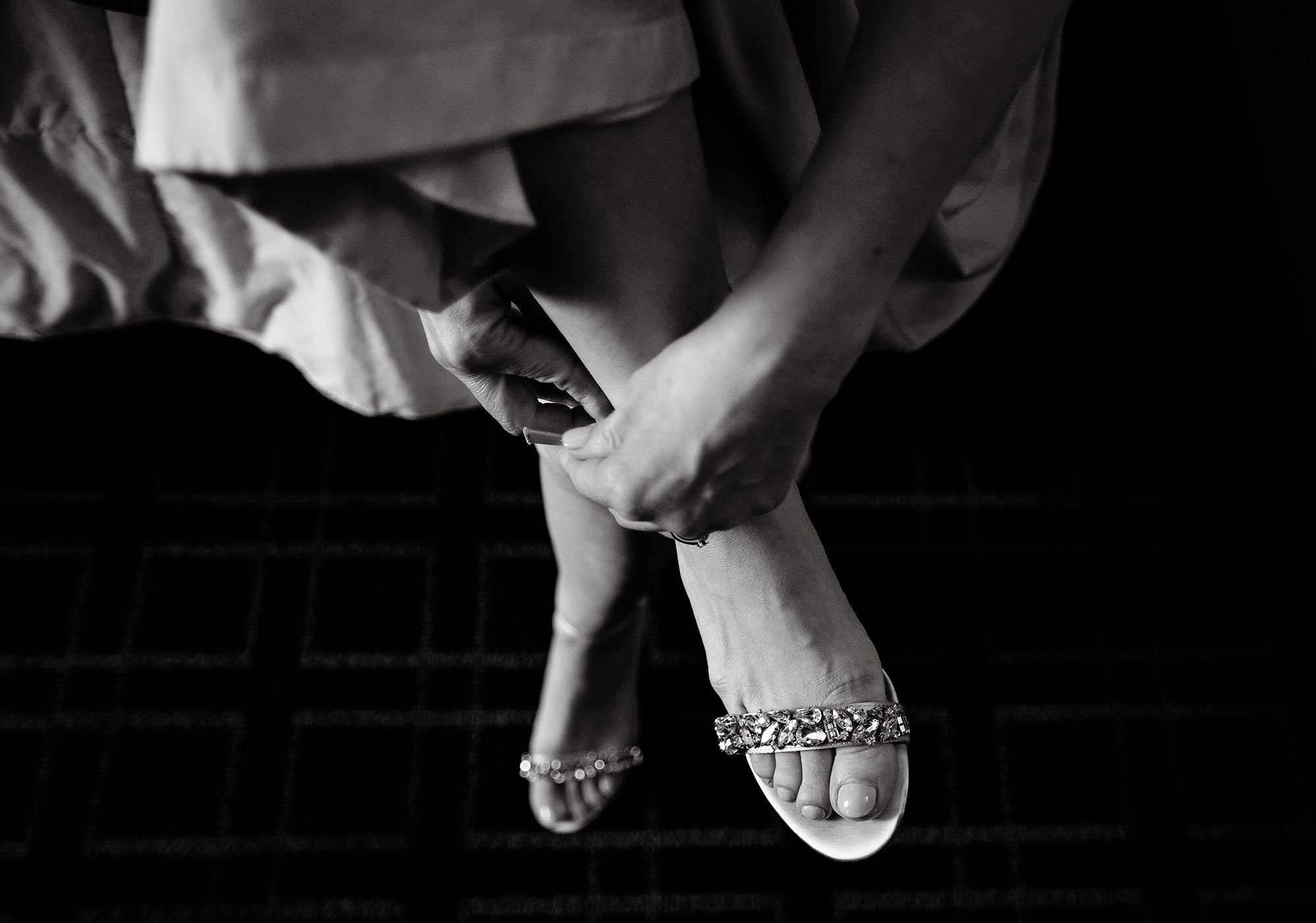 Loft at 600 F Wedding  I  A bridesmaid puts on her shoes.