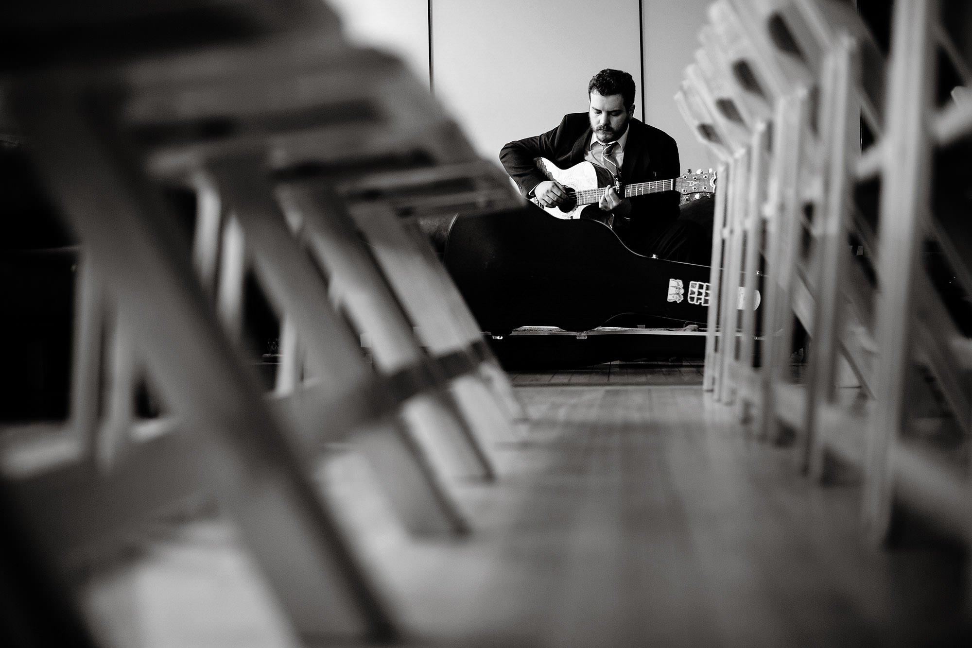 Loft at 600 F Wedding  I  A guitarist prepares for the wedding ceremony in Washington, DC.